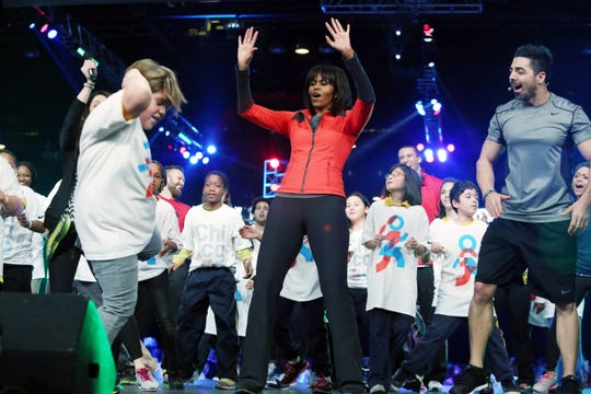 Michelle Obama dances with Chicago  school children in her Let's Move program on Feb. 28, 2013.