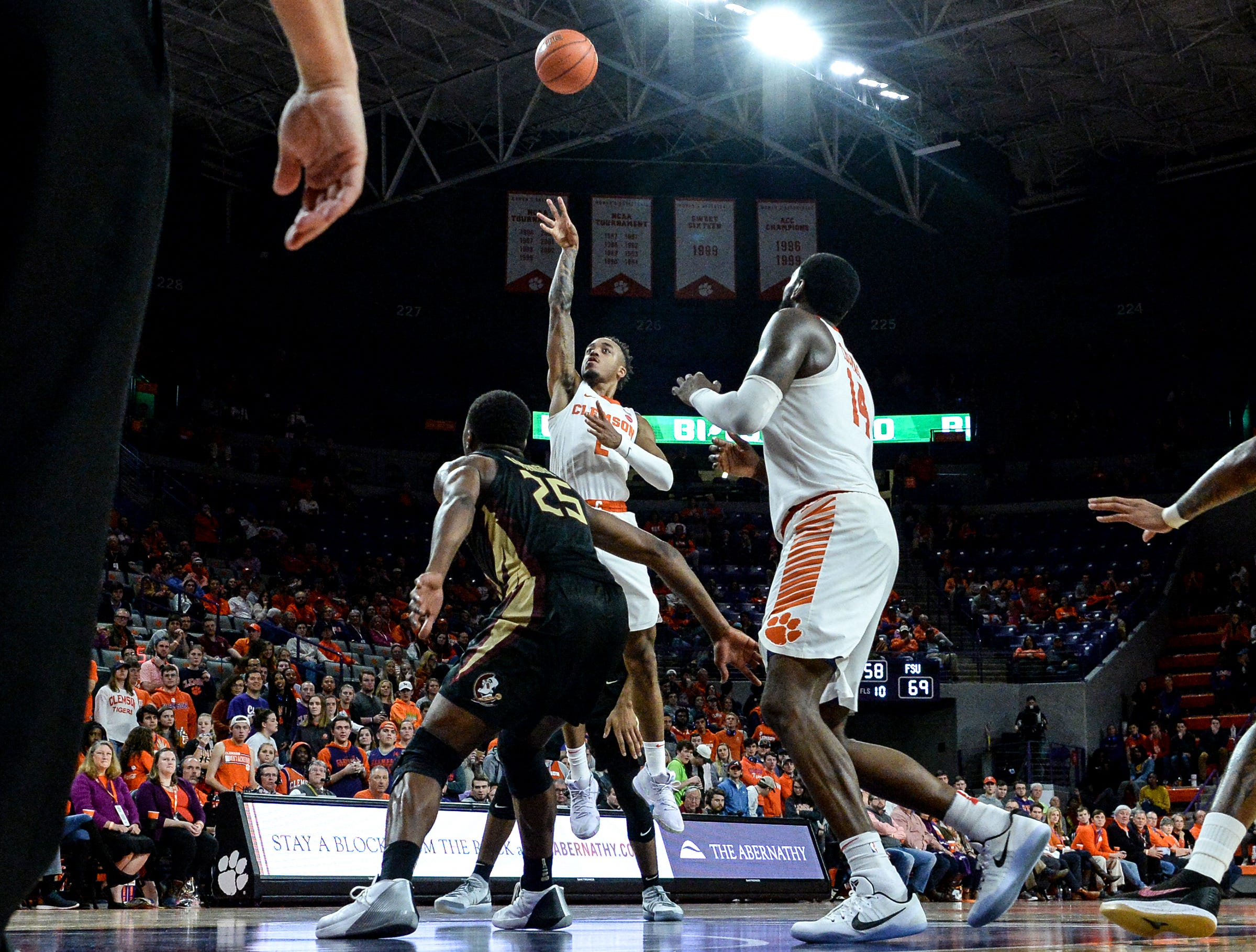 Clemson guard Marcquise Reed (2) shoots near Florida State forward Mfiondu Kabengele(25) during the second half at Littlejohn Coliseum in Clemson Tuesday, February 19, 2019.