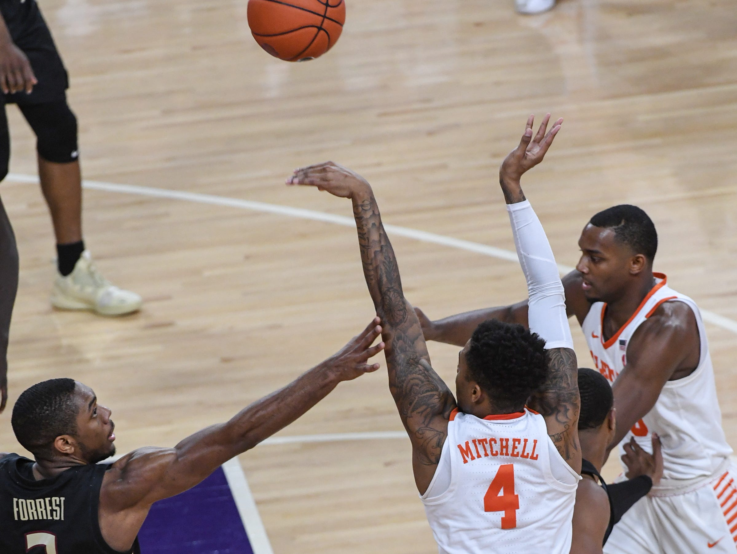 Clemson guard Shelton Mitchell (4) shoots near Florida State guard Trent Forrest(3) during the first half at Littlejohn Coliseum in Clemson Tuesday, February 19, 2019.