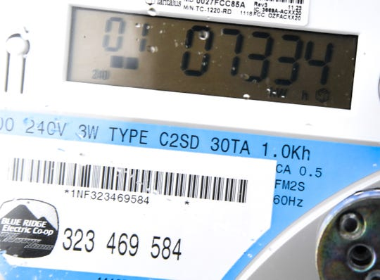 "A Blue Ridge Electric ""smart"" meter at the home of Tabitha Riley Monday. Riley said the power bill rose dramatically after the new meter was installed at the residence."