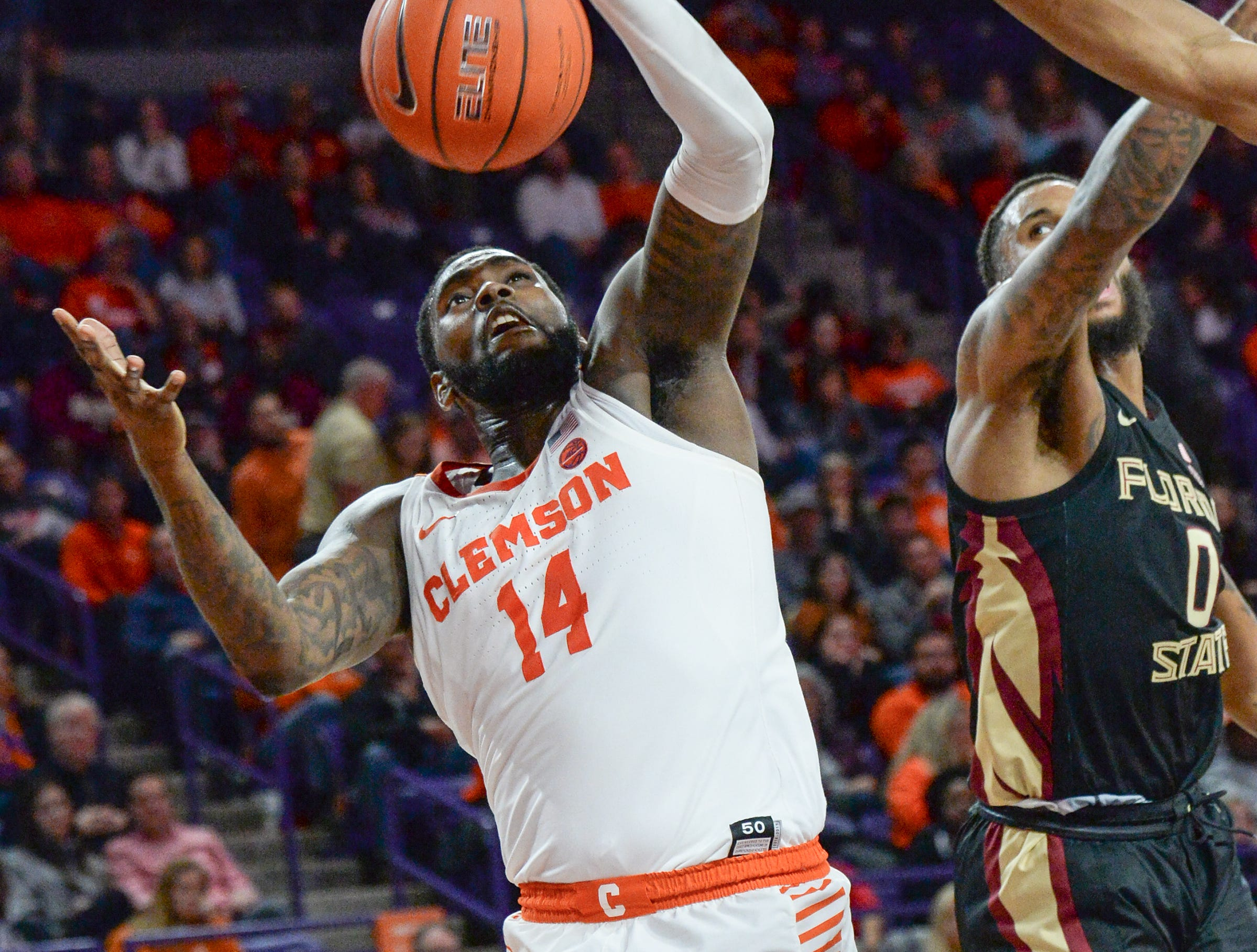 Clemson forward Elijah Thomas (14) rebounds near Florida State forward Phil Cofer(0) during the first half at Littlejohn Coliseum in Clemson Tuesday, February 19, 2019.