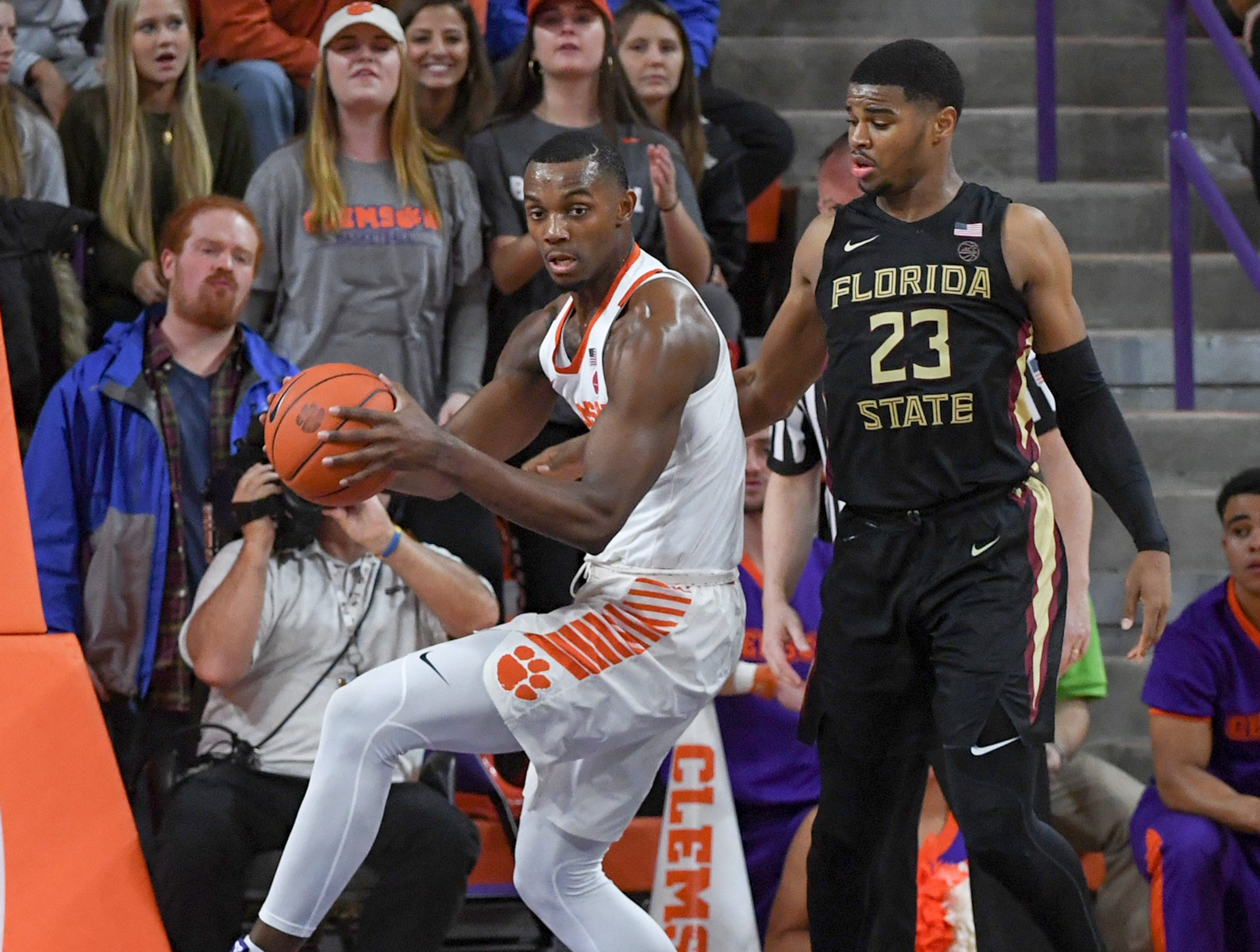 Clemson forward Aamir Simms (25) rebounds near Florida State guard M.J. Walker(23) during the second half at Littlejohn Coliseum in Clemson Tuesday, February 19, 2019.
