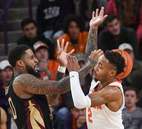 Clemson guard Marcquise Reed (2) and Florida State forward Phil Cofer(0) reach for a loose ball during the second half at Littlejohn Coliseum in Clemson Tuesday, February 19, 2019.