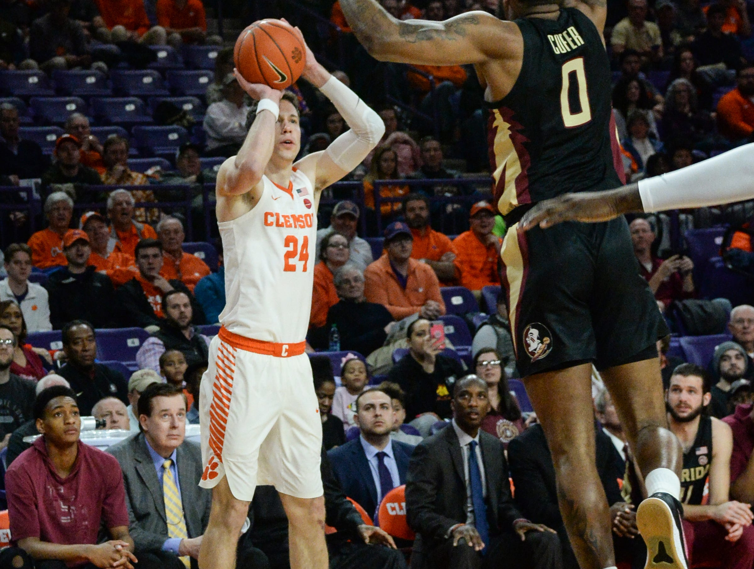 Clemson forward David Skara (24) shoots near Florida State forward Phil Cofer(0) during the first half at Littlejohn Coliseum in Clemson Tuesday, February 19, 2019.
