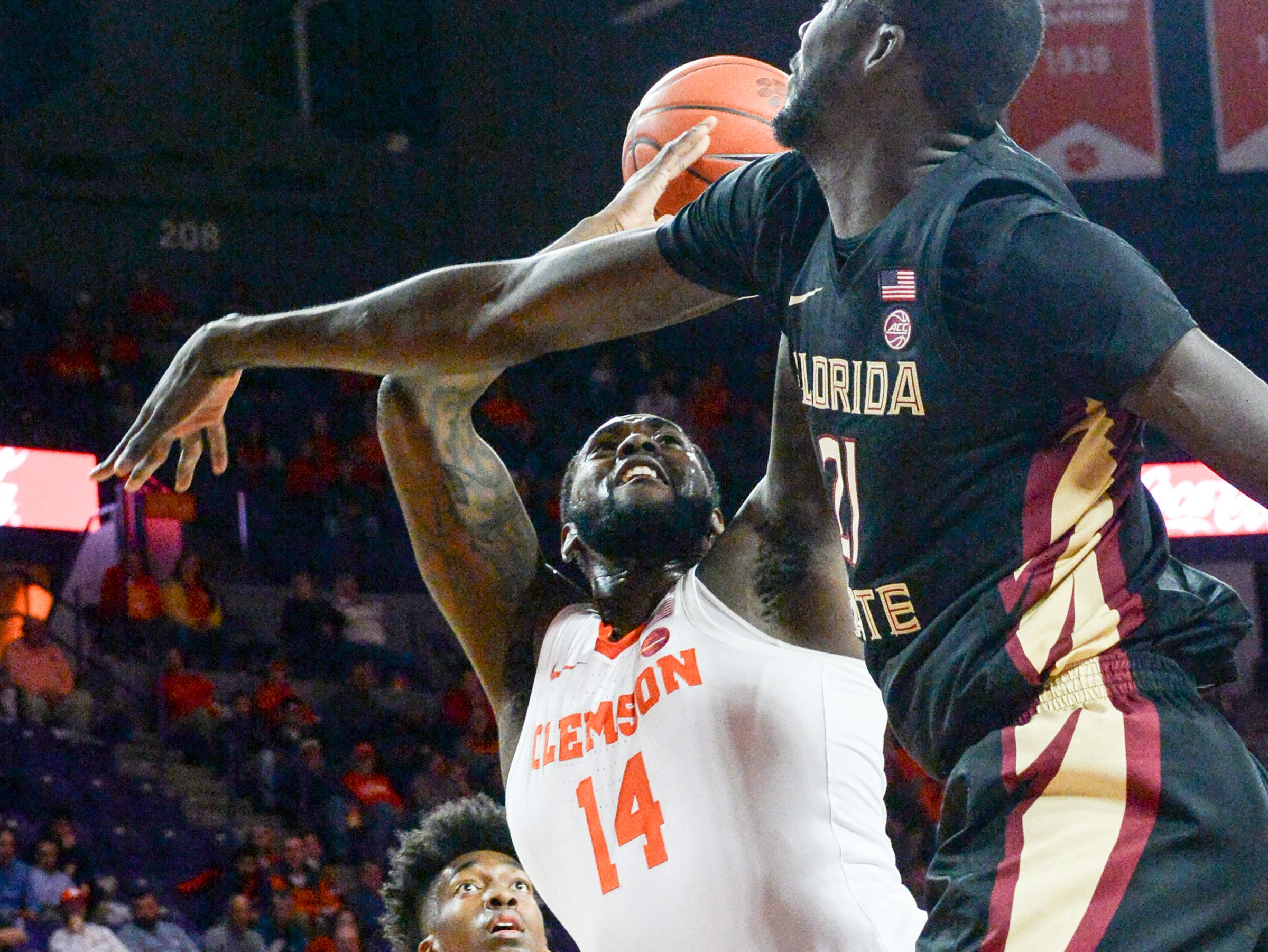 Clemson forward Elijah Thomas (14) shoots near Florida State center Christ Koumadje(21) during the first half at Littlejohn Coliseum in Clemson Tuesday, February 19, 2019.