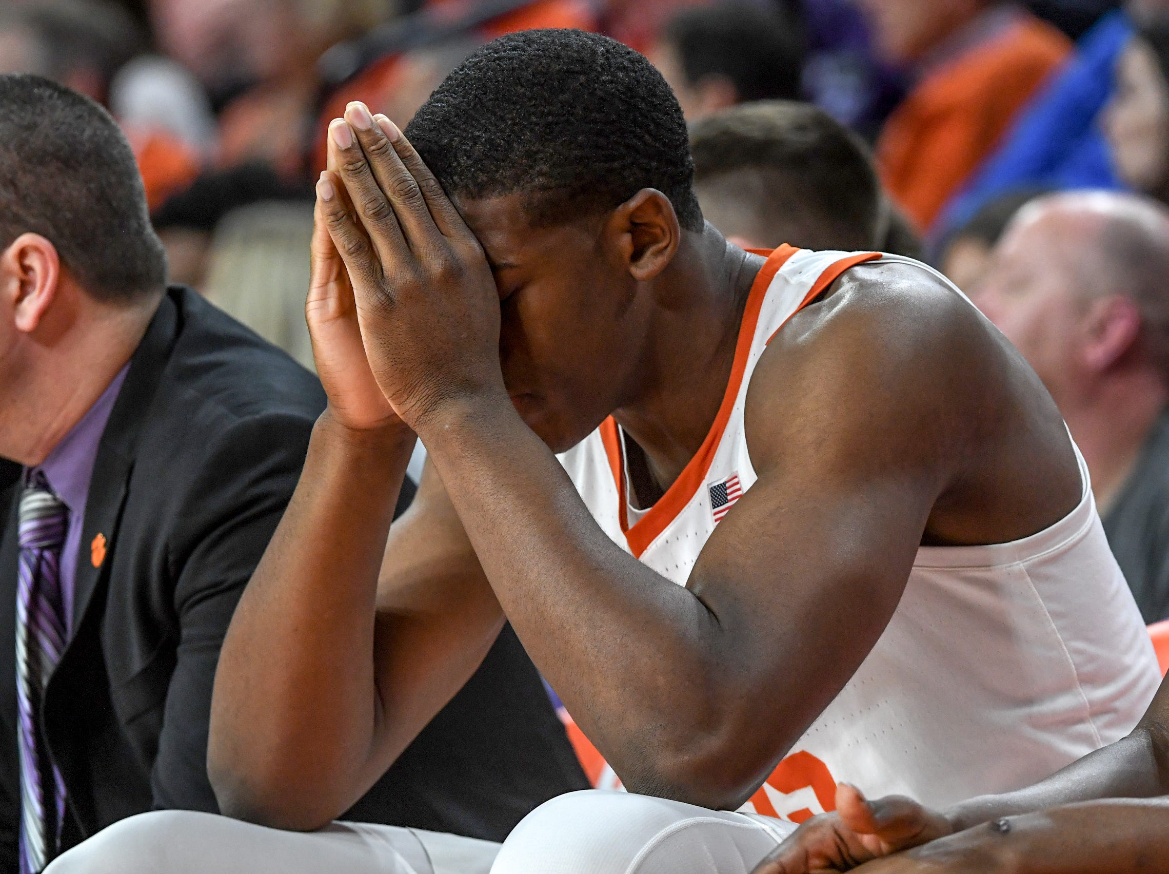 Clemson center Trey Jemison (55) holds his hands to his face in the closing minutes of the game with Florida State during the second half at Littlejohn Coliseum in Clemson Tuesday, February 19, 2019.