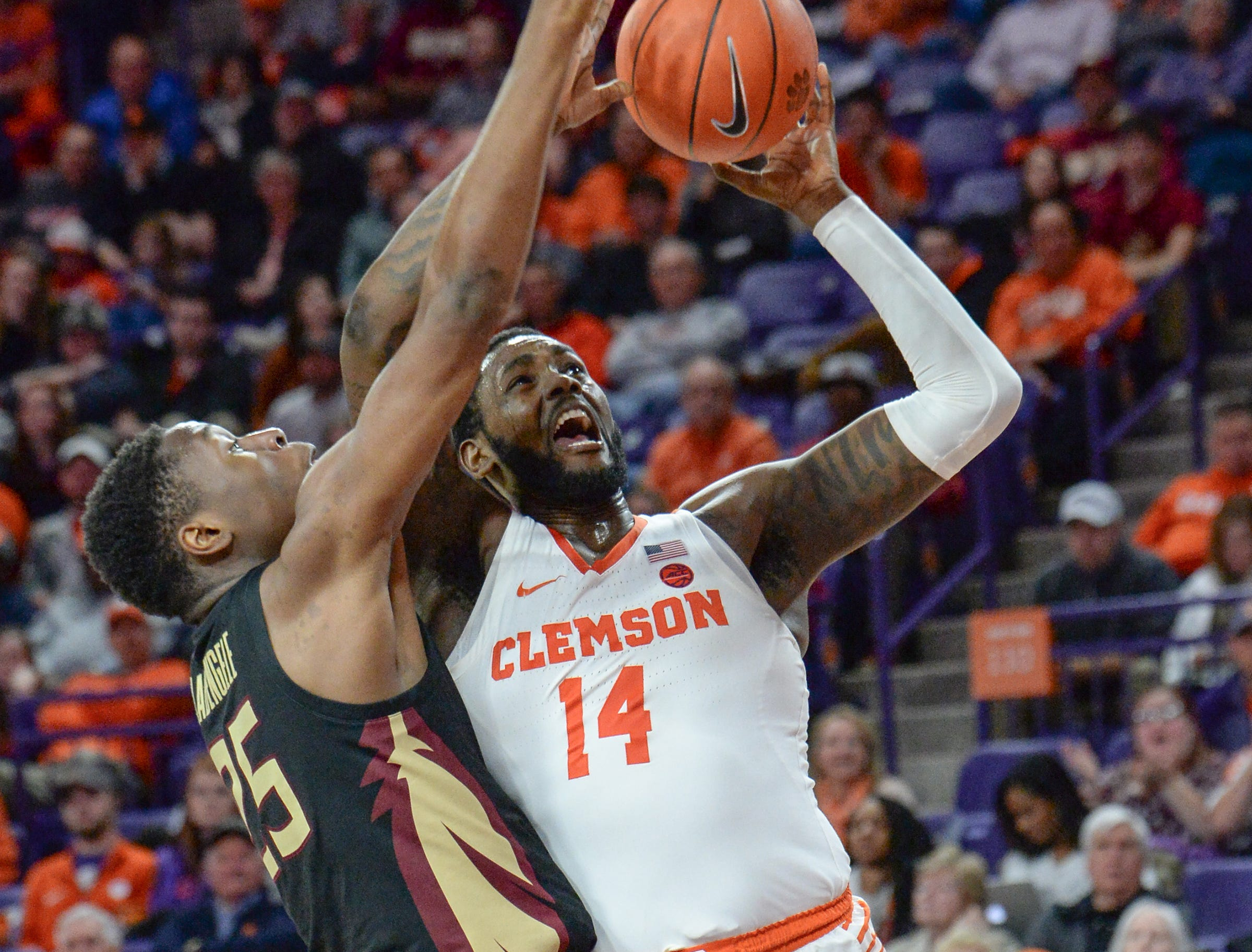 Clemson forward Elijah Thomas (14) shoots near Florida State forward Mfiondu Kabengele(25) during the second half at Littlejohn Coliseum in Clemson Tuesday, February 19, 2019.