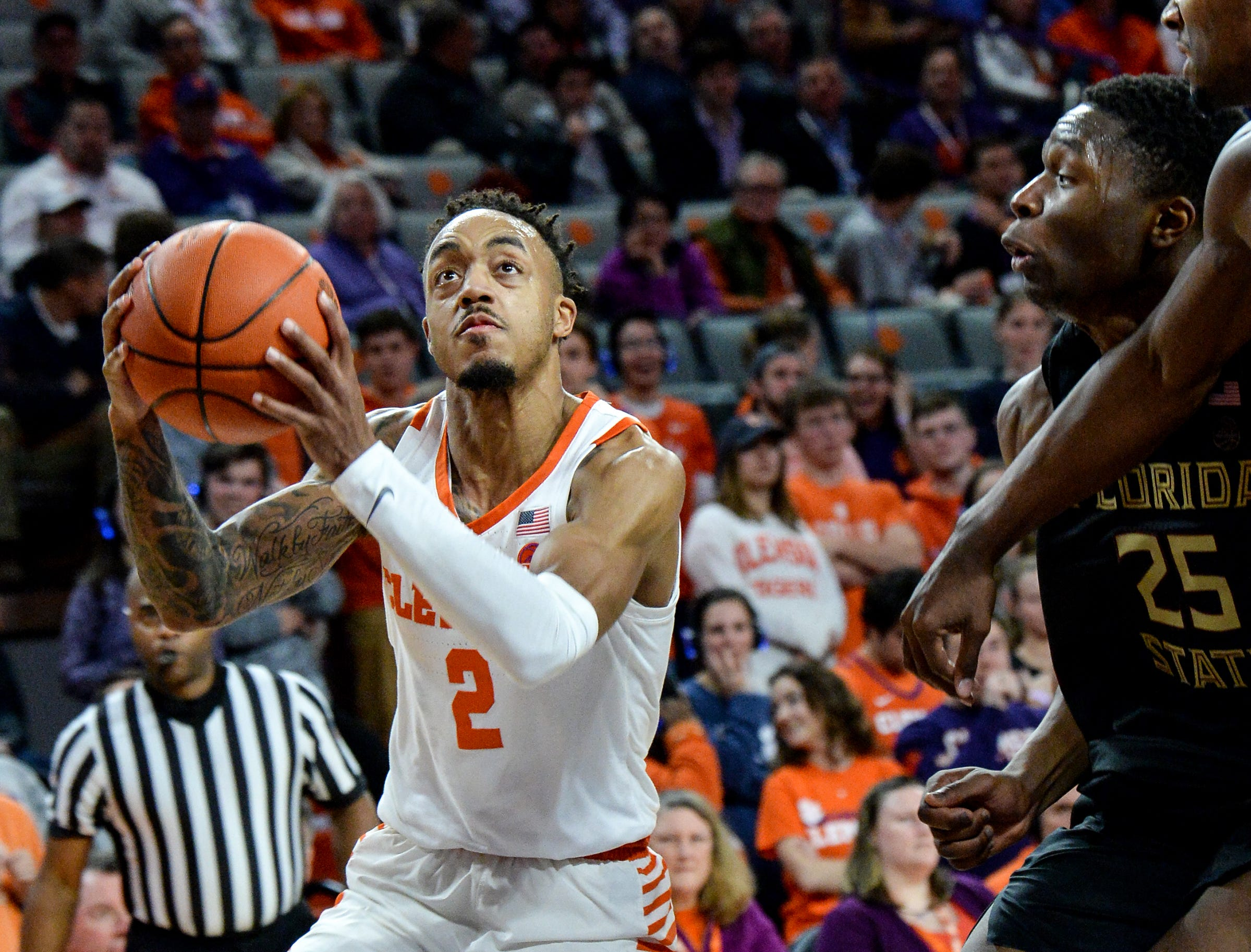 Clemson guard Marcquise Reed (2) scores near Florida State forward Mfiondu Kabengele(25) during the second half at Littlejohn Coliseum in Clemson Tuesday, February 19, 2019.