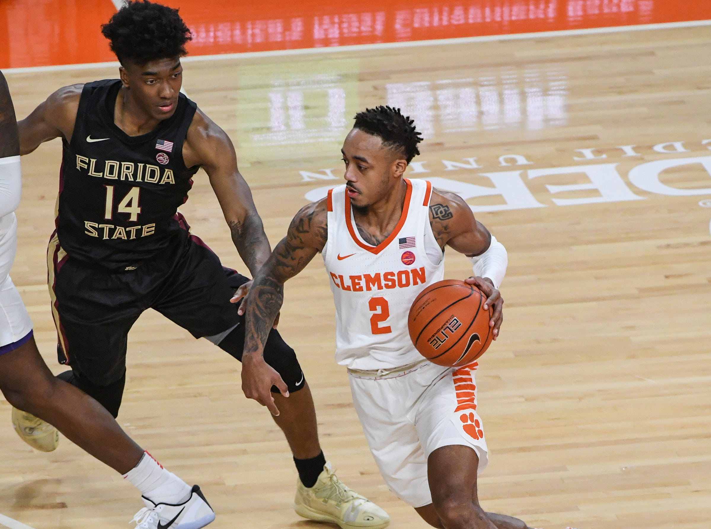Clemson guard Marcquise Reed (2) dribbles bear Florida State guard Terence Mann(14) during the first half at Littlejohn Coliseum in Clemson Tuesday, February 19, 2019.