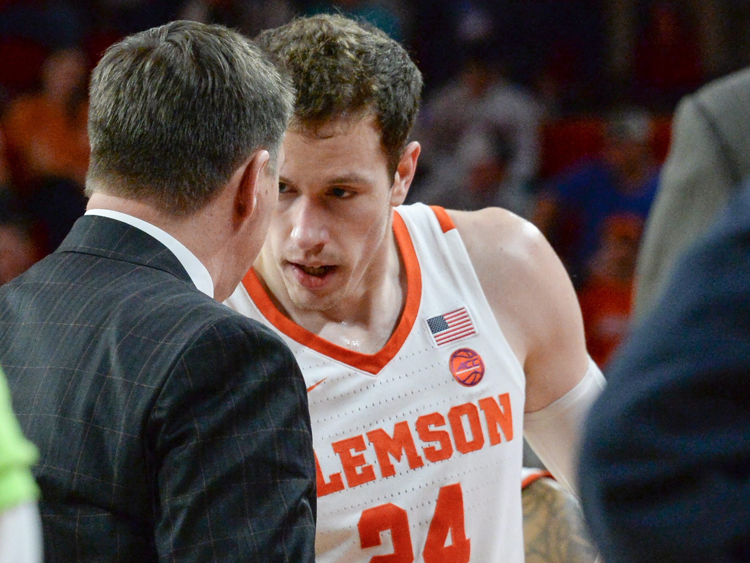 Clemson head coach Brad Brownell talks with Clemson forward David Skara (24) in a timeout from playing Florida State during the second half at Littlejohn Coliseum in Clemson Tuesday, February 19, 2019.