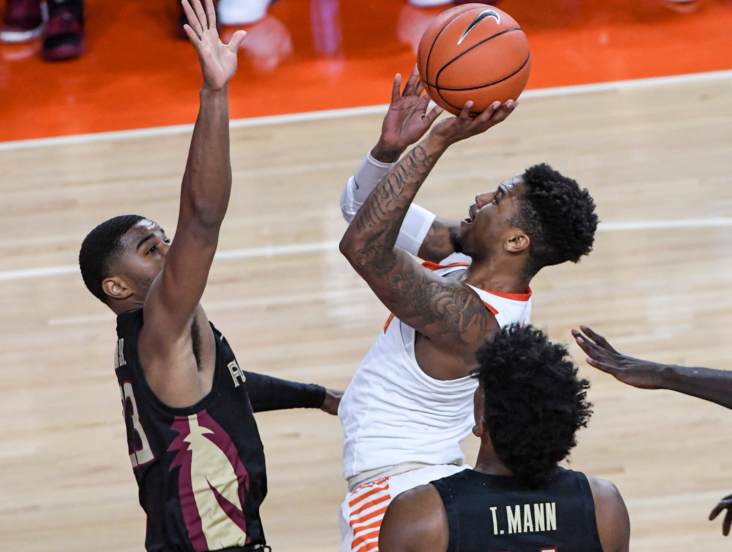 Clemson guard Shelton Mitchell (4) shoots near Florida State guard M.J. Walker(23) during the first half at Littlejohn Coliseum in Clemson Tuesday, February 19, 2019.
