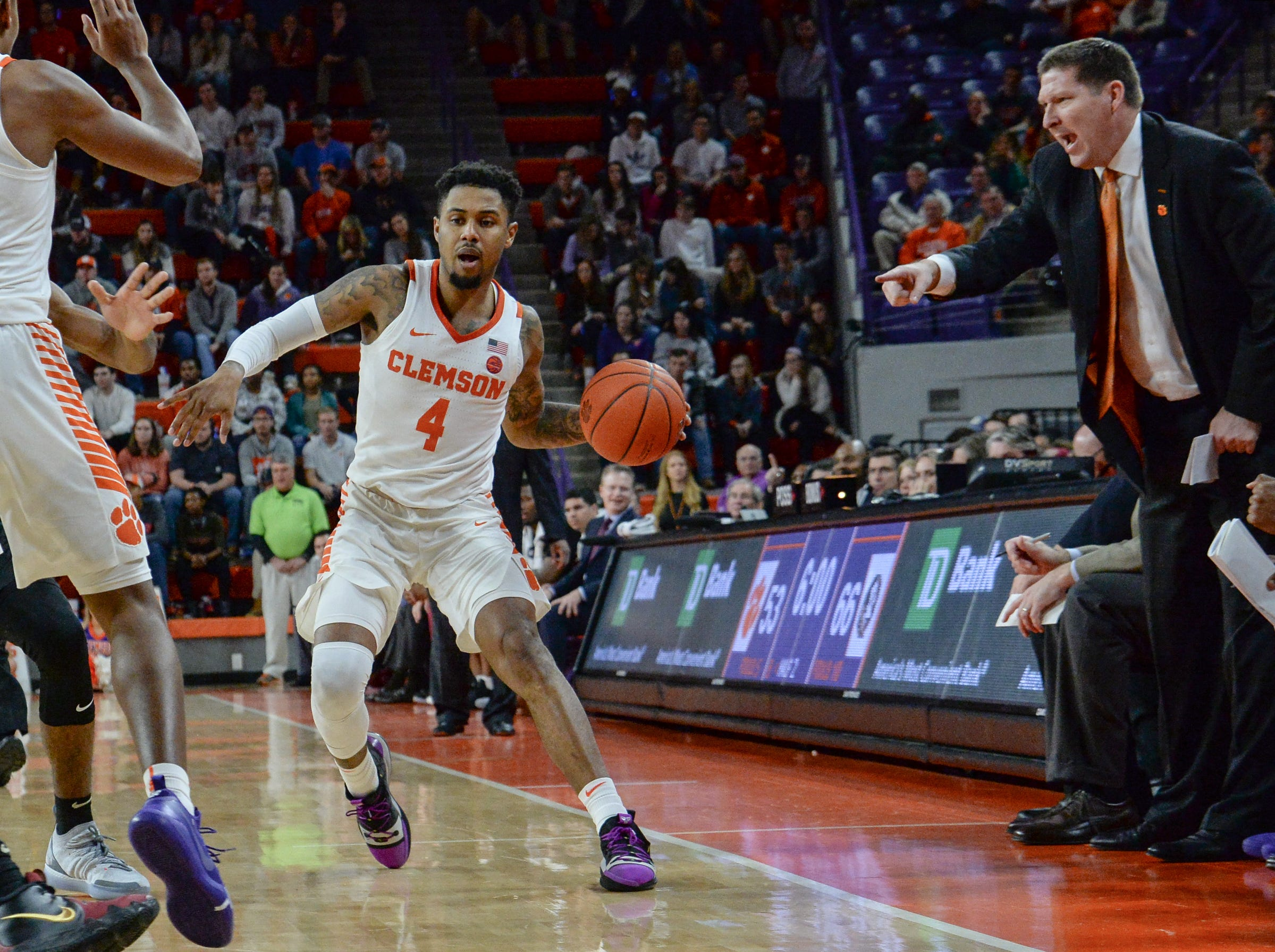 Clemson head coach Brad Brownell gives direction as Clemson guard Shelton Mitchell (4) dribbles playing Florida State during the second half at Littlejohn Coliseum in Clemson Tuesday, February 19, 2019.