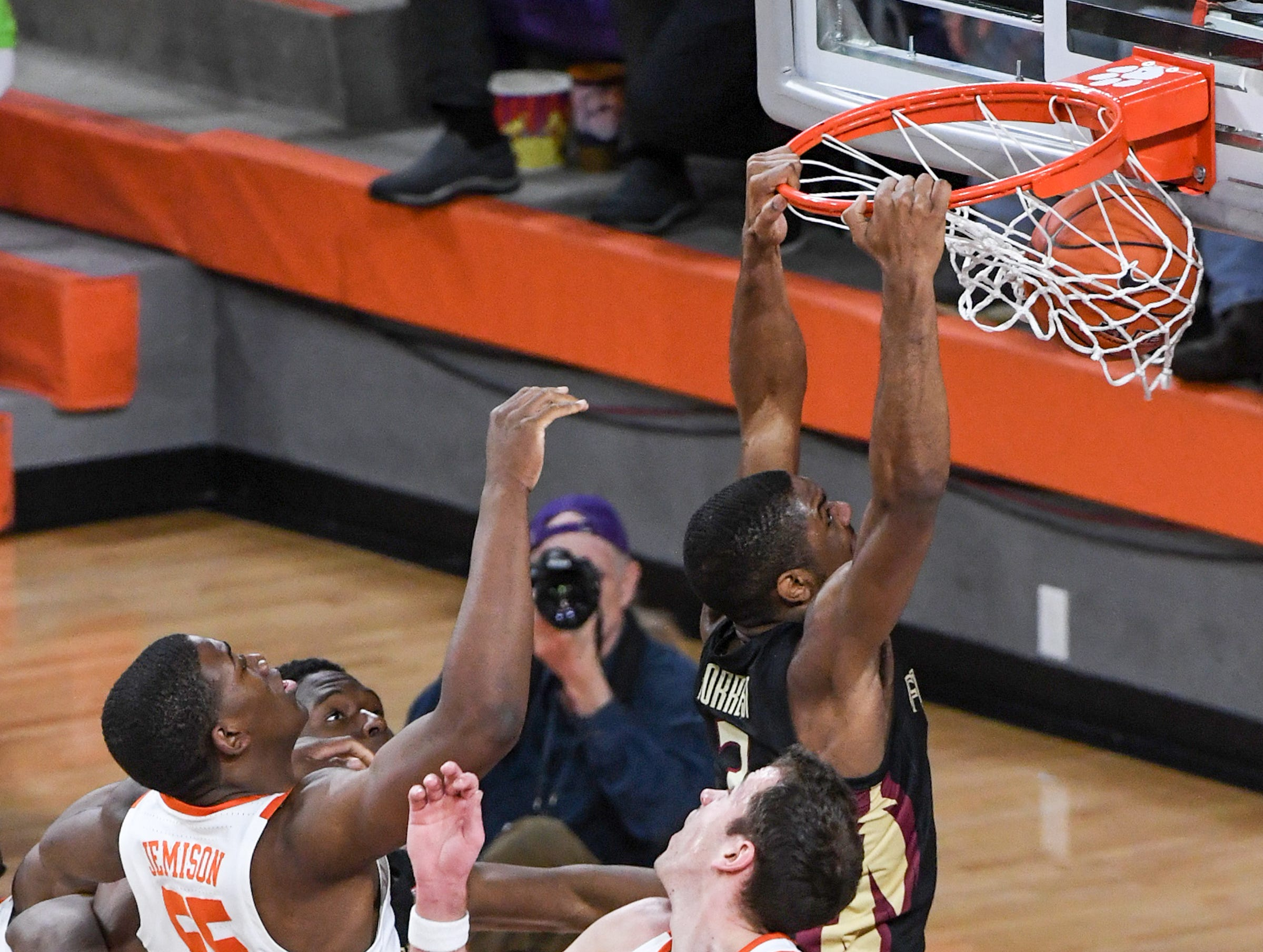 Florida State guard Trent Forrest(3) dunks between Clemson center Trey Jemison (55) and Clemson forward David Skara (24) during the first half at Littlejohn Coliseum in Clemson Tuesday, February 19, 2019.