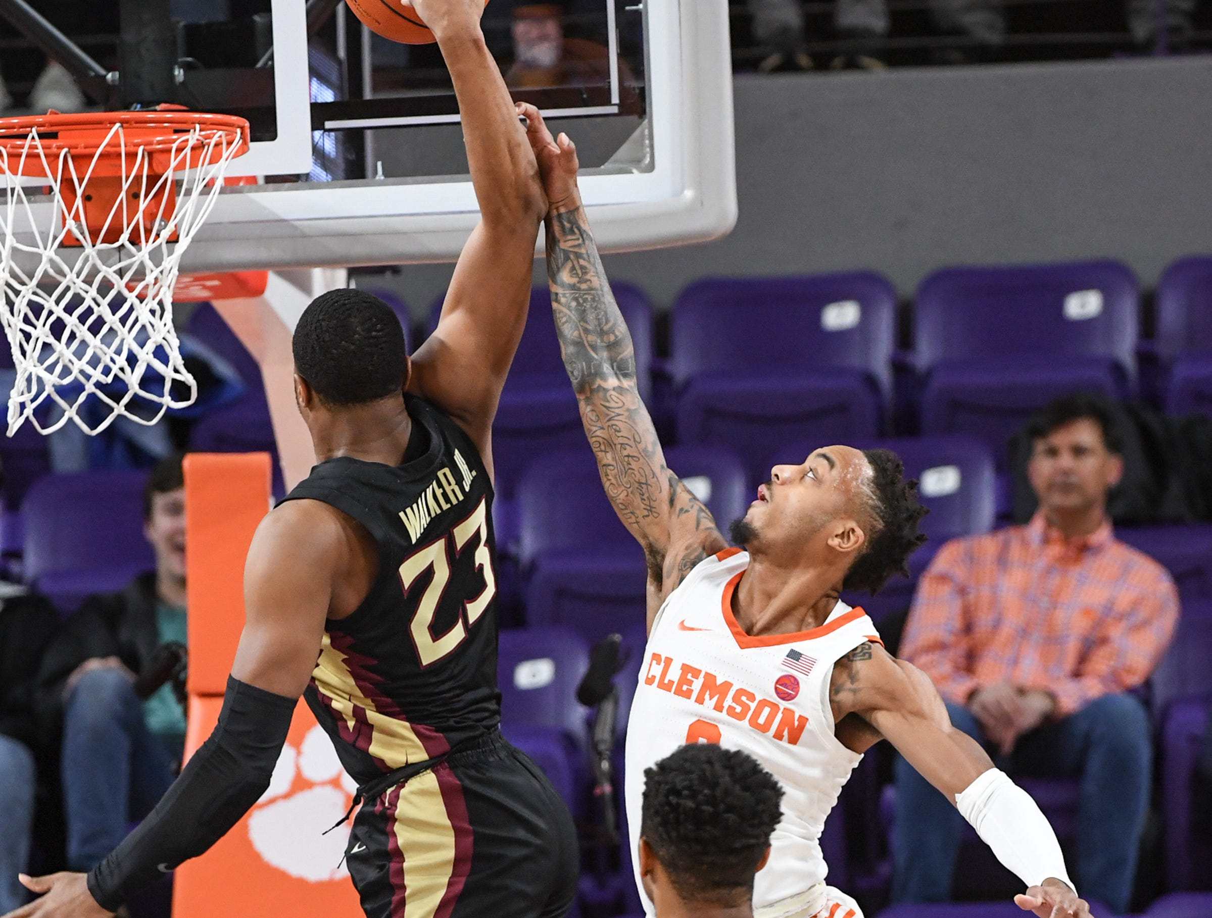 Clemson guard Marcquise Reed (2) defends Florida State guard M.J. Walker(23) during the first half at Littlejohn Coliseum in Clemson Tuesday, February 19, 2019.