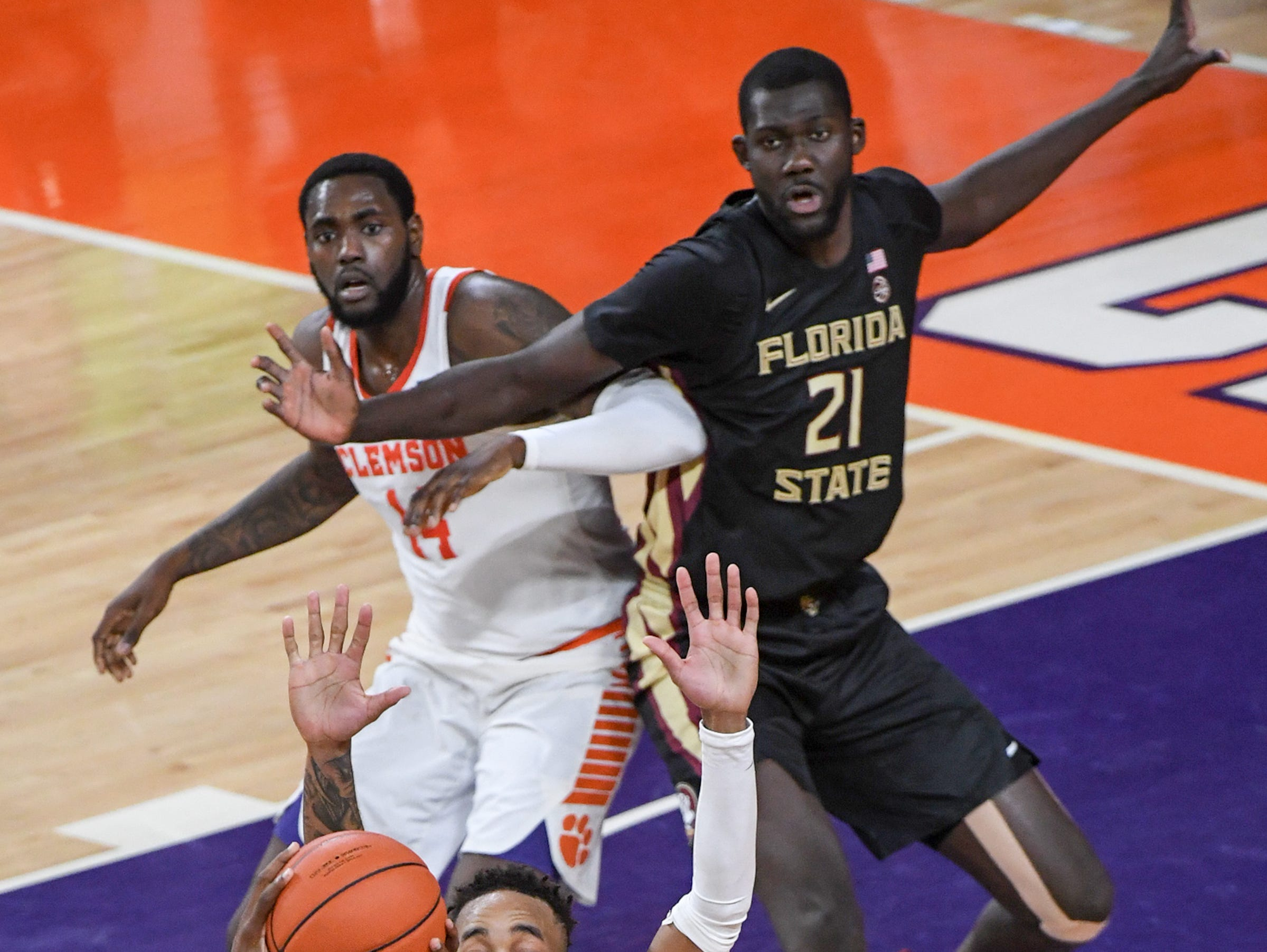 Clemson guard Marcquise Reed (2) defends Florida State guard Terence Mann(14) looking to pass to Florida State center Christ Koumadje(21) checked by Clemson forward Elijah Thomas (14) during the first half at Littlejohn Coliseum in Clemson Tuesday, February 19, 2019.