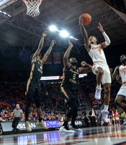 Clemson guard Marcquise Reed (2) shoots near Florida State guard PJ Savoy(5) during the first half at Littlejohn Coliseum in Clemson Tuesday, February 19, 2019.