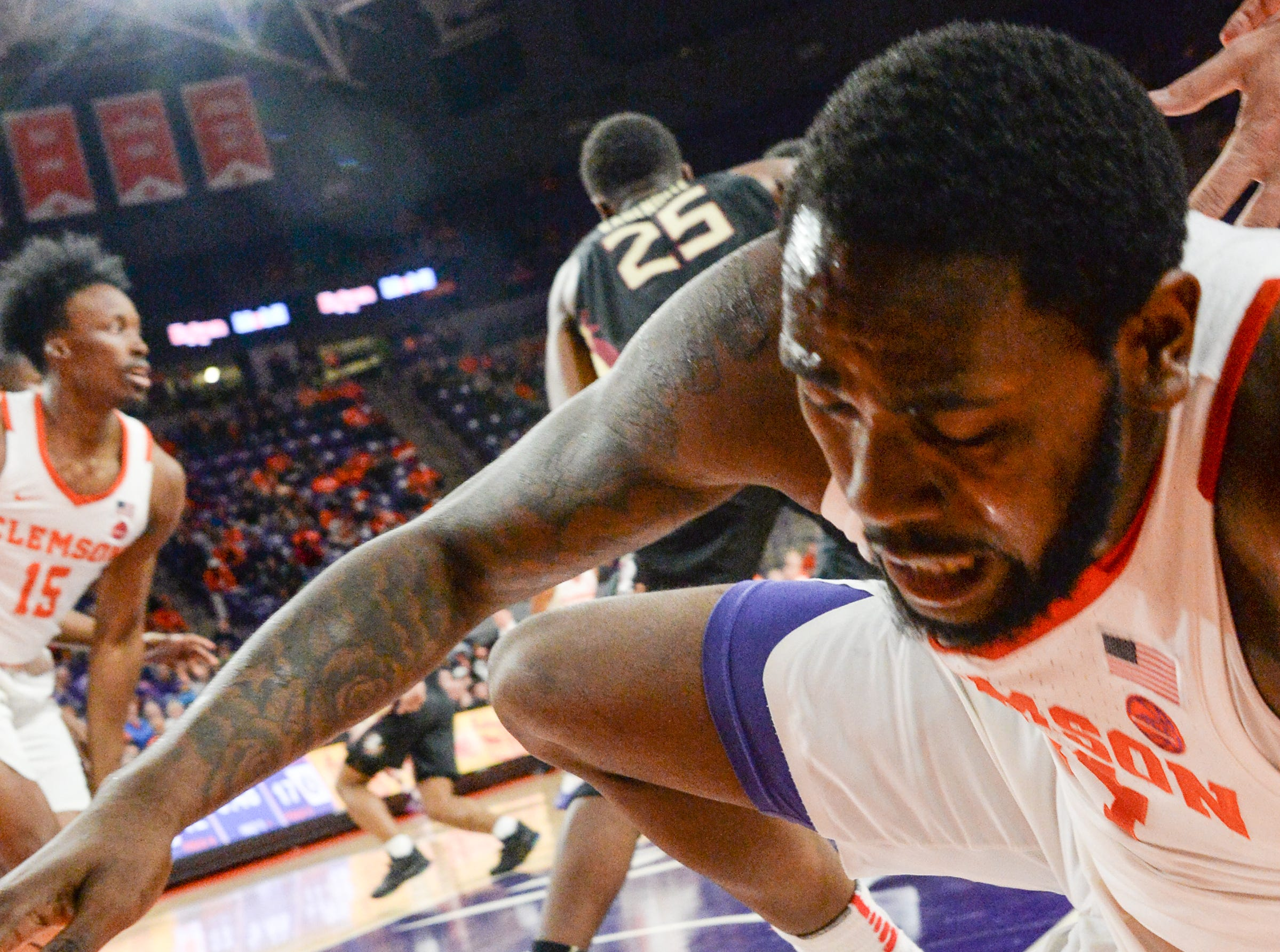 Clemson forward Elijah Thomas (14) falls to the floor after trying to get a rebound near Florida State forward Mfiondu Kabengele(25) during the first half at Littlejohn Coliseum in Clemson Tuesday, February 19, 2019.