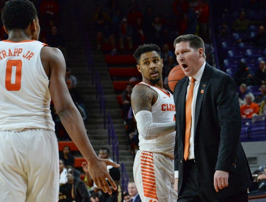 Clemson head coach Brad Brownell talks with Clemson center Clyde Trapp (0) at a break playing Florida State during the second half at Littlejohn Coliseum in Clemson Tuesday, February 19, 2019.