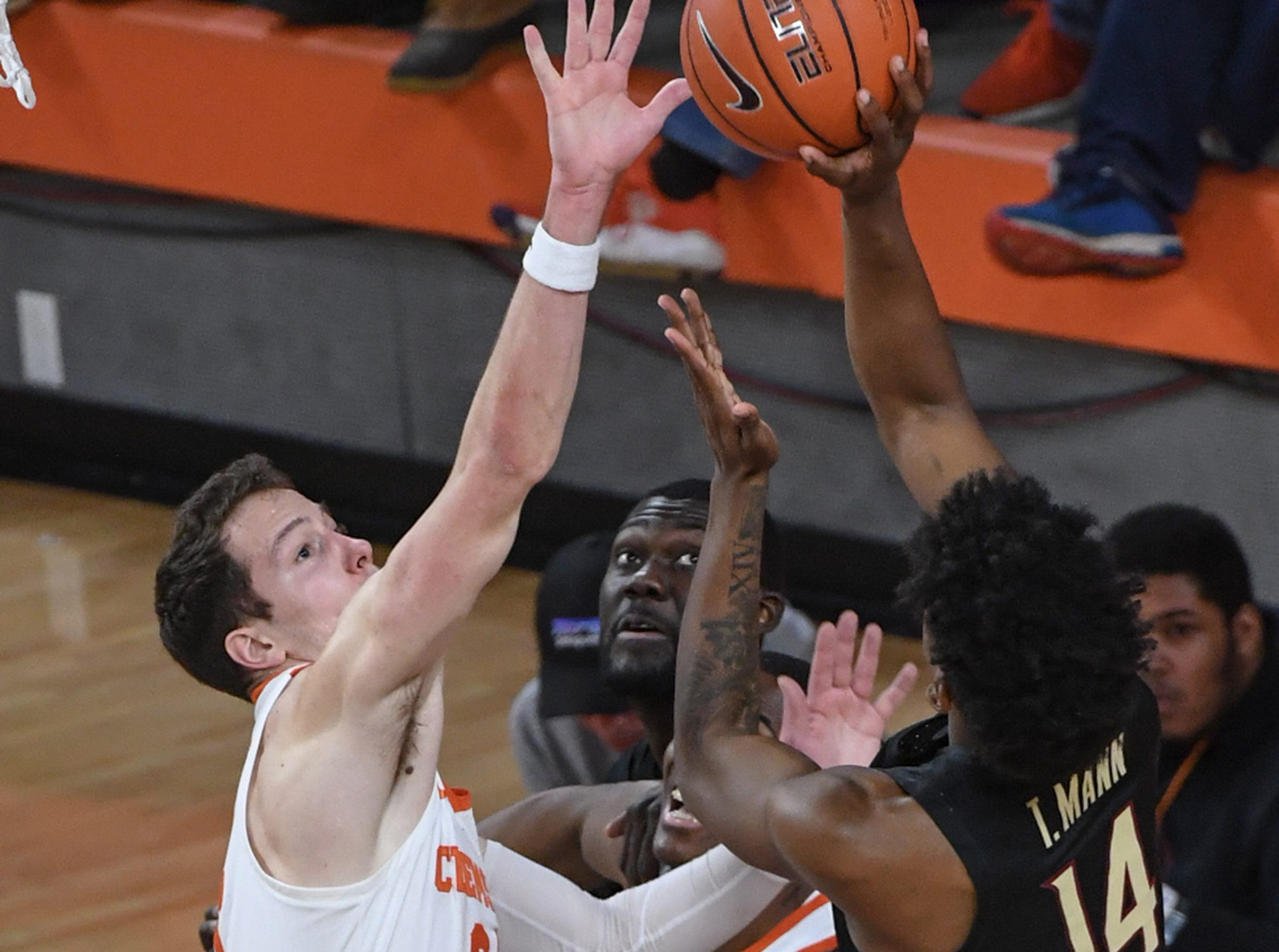 Clemson forward David Skara (24) defends a shot by Florida State guard Terence Mann(14) during the first half at Littlejohn Coliseum in Clemson Tuesday, February 19, 2019.