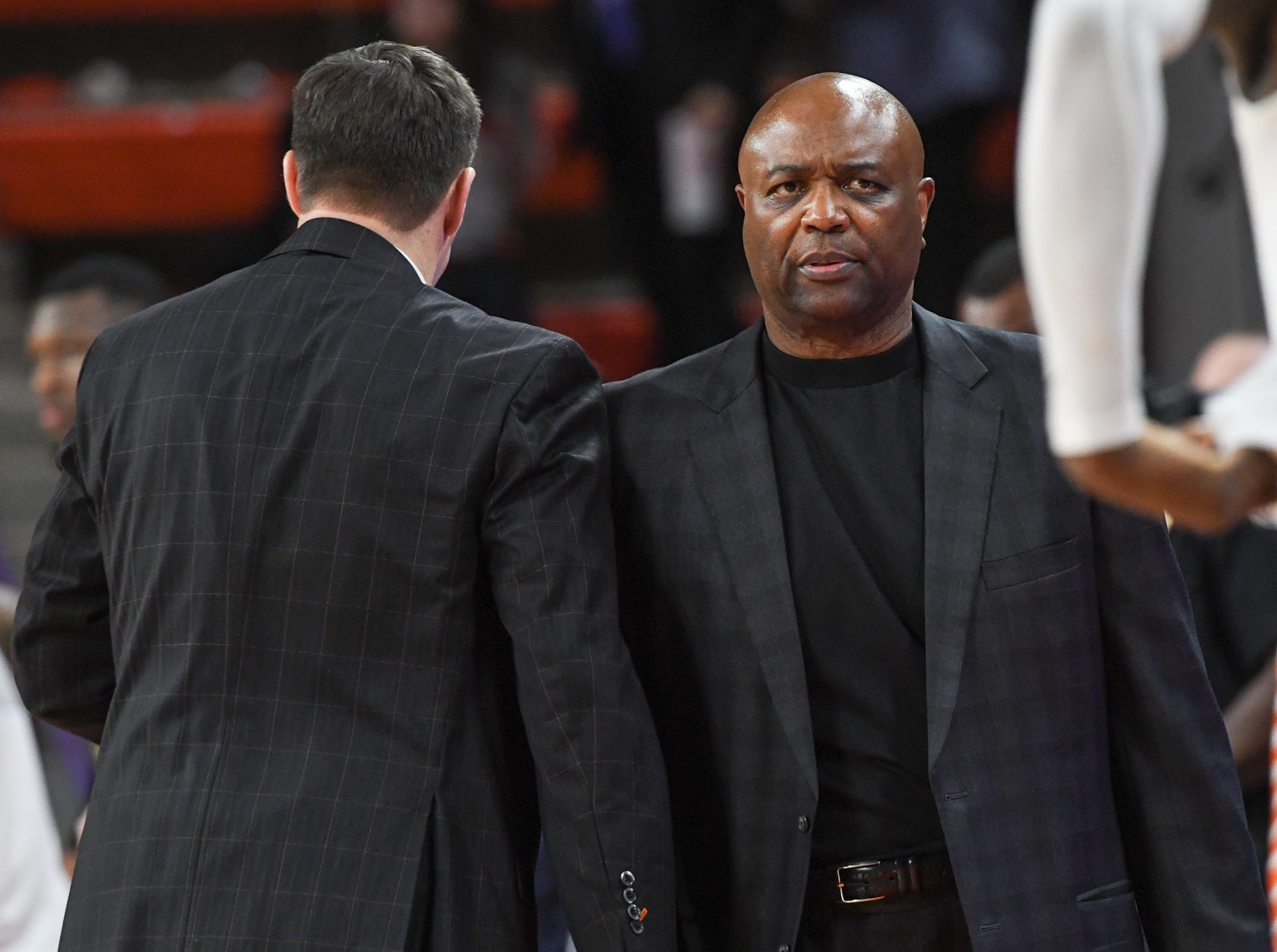 Clemson head coach Brad Brownell, left, shakes hands with Florida State Leonard Hamilton after the game at Littlejohn Coliseum in Clemson Tuesday, February 19, 2019.