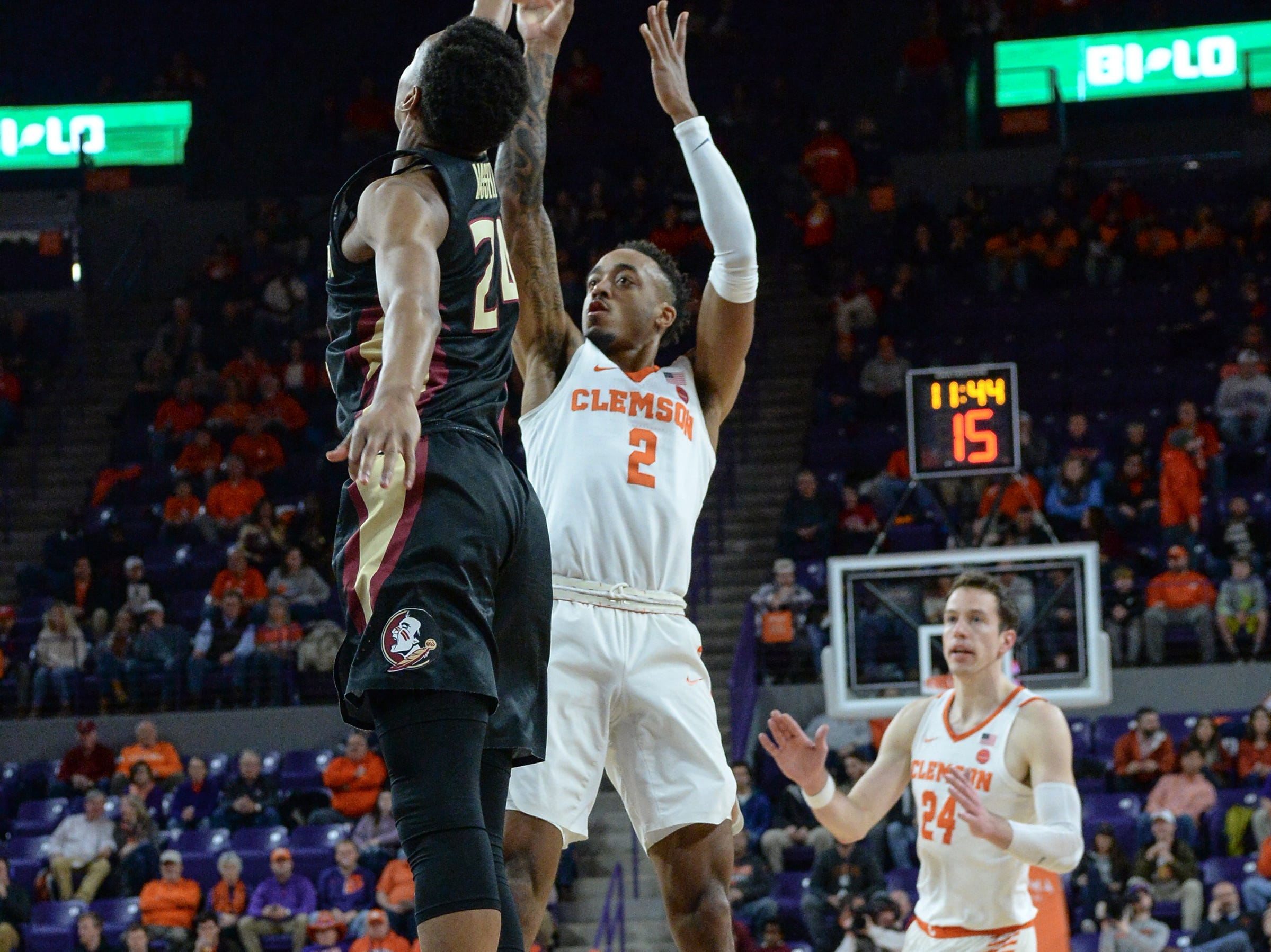 Clemson guard Marcquise Reed (2) shoots near Florida State guard M.J. Walker(23) during the first half at Littlejohn Coliseum in Clemson Tuesday, February 19, 2019.