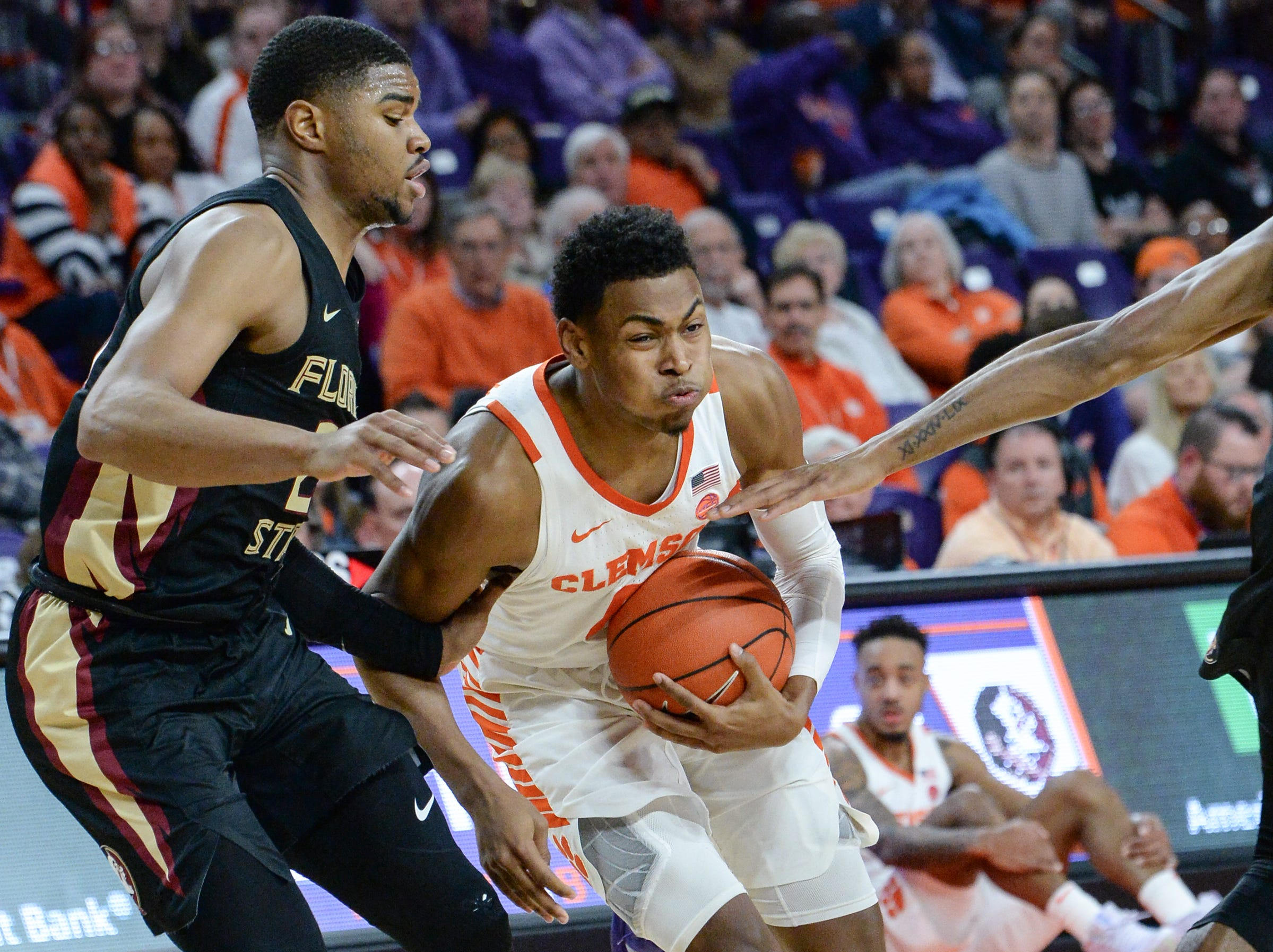 Clemson center Clyde Trapp (0) dribbles near Florida State guard M.J. Walker(23) during the first half at Littlejohn Coliseum in Clemson Tuesday, February 19, 2019.