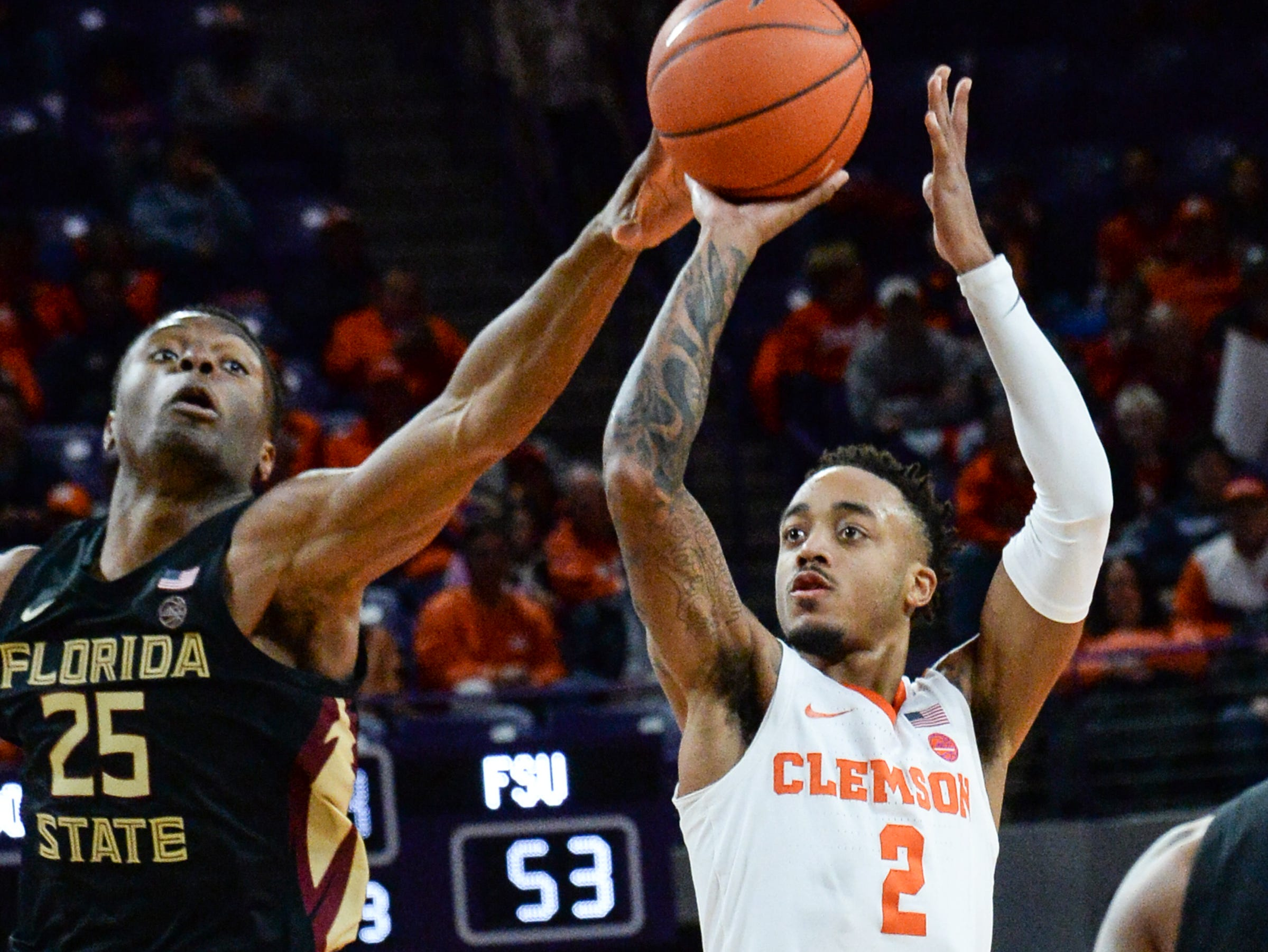 Clemson guard Marcquise Reed (2) shoots near Clemson forward Aamir Simms (25) during the second half at Littlejohn Coliseum in Clemson Tuesday, February 19, 2019.