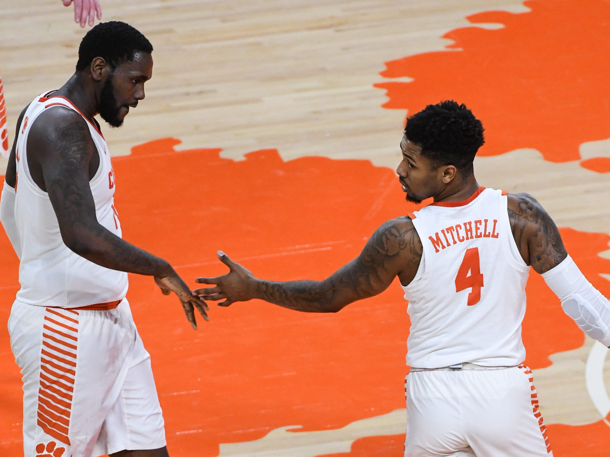 Clemson forward Elijah Thomas (14) congratulates Clemson guard Shelton Mitchell (4) after he made a thre-pointer against Florida State during the first half at Littlejohn Coliseum in Clemson Tuesday, February 19, 2019.