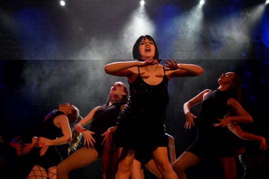 """Mia Huffman (center) as murderess Velma Kelly in Pineville High School Theatre's production of """"Chicago (High School Edition)."""" With her are ensemble members Stephanie McQuain, Grace Roberts, Carmen Taffi, Kailla Lorenzo and Emily Mackey. The musical is set to open at 7 p.m. Thursday, Feb. 21, 2019 in the PHS auditorium. The show will be at 7 p.m. Friday and Saturday and at 2 p.m. Sunday. Tickets are $13.50 for adults, $10.50 for seniors and $8.50 for students. The musical, set in Chicago the 1920s, is about a married woman named Roxie Hart who murders a man with which she is having an affair. She is convicted and sentenced to death. She and another convict at the prison, Velma Kelly, vie for fame, fortune and headlines in the newspapers. Alyssa McClain stars as Roxie; Mia Huffman as Velma; Nico Zona as Billy Flynn; Gabrielle Bernard as Matron """"Mama"""" Morton and Kaiden Carbaugh as Amos Hart. Tickets can be purchased at www.pinevillehightheatre.net."""