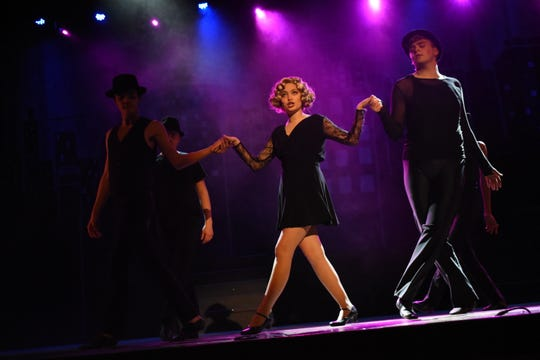 """Alyssa McClain (center) stars as murderess Roxie Hart in Pineville High School Theatre's production of """"Chicago (High School Edition)."""" Performing a musical number with her are ensemble cast members Avery Thompson, Jackson Price, Jose Rivera and Jacob Ramos. The musical is set to open at 7 p.m. Thursday, Feb. 21, 2019 in the PHS auditorium. The show will be at 7 p.m. Friday and Saturday and at 2 p.m. Sunday. Tickets are $13.50 for adults, $10.50 for seniors and $8.50 for students. The musical, set in Chicago the 1920s, is about a married woman named Roxie Hart who murders a man with which she is having an affair. She is convicted and sentenced to death. She and another convict at the prison, Velma Kelly, vie for fame, fortune and headlines in the newspapers. Mia Huffman stars as Velma; Nico Zona as Billy Flynn; Gabrielle Bernard as Matron """"Mama"""" Morton and Kaiden Carbaugh as Amos Hart. Tickets can be purchased at www.pinevillehightheatre.net."""