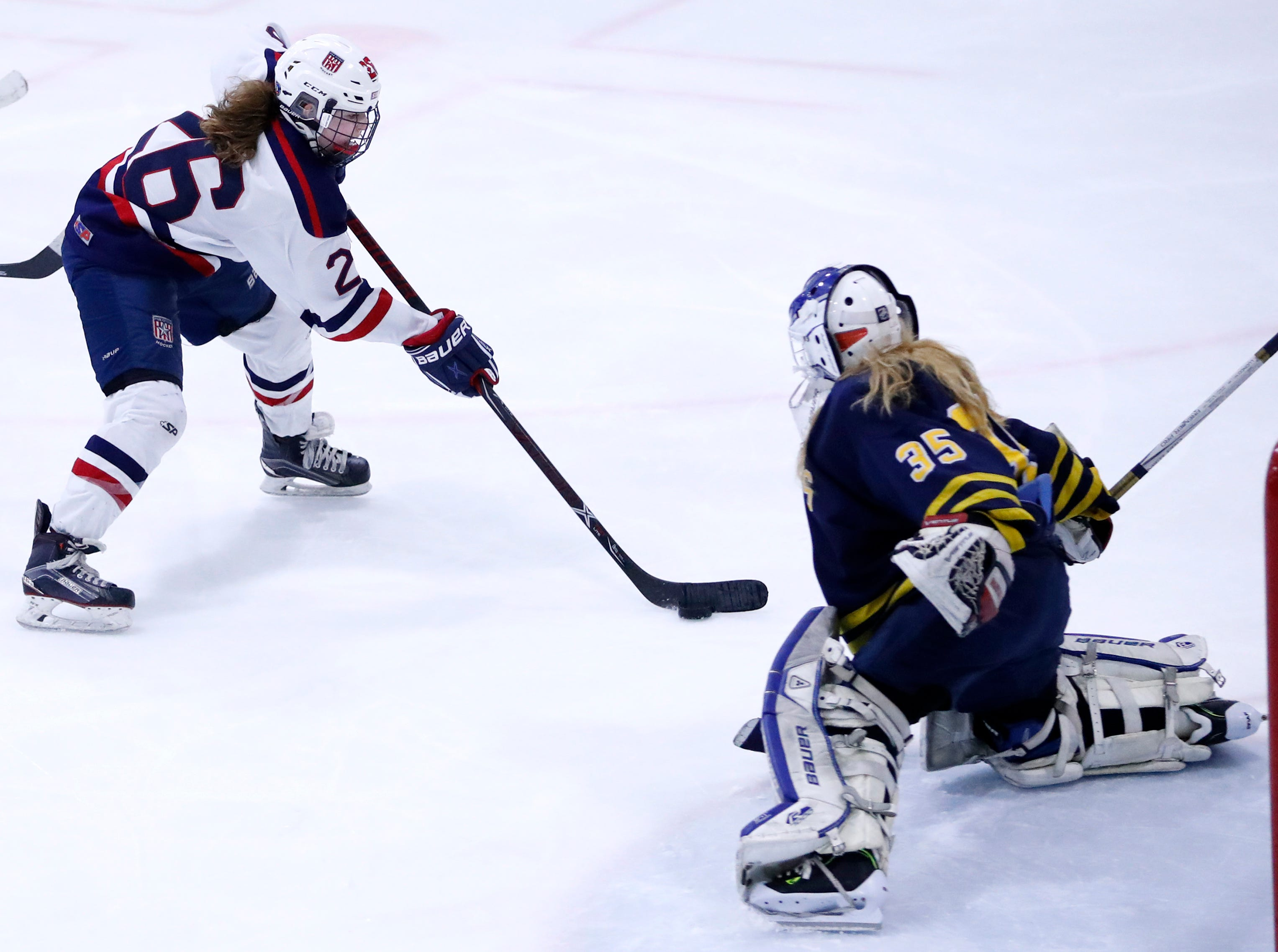 Fox Cities StarsÕ McKayla Zilisch works her way to the goal before scoring on University School Co-opÕs Sami Stommel during their sectional semifinal Tuesday, Feb. 19, 2019, at the Tri-County Ice Arena in Neenah, Wis.Danny Damiani/USA TODAY NETWORK-Wisconsin