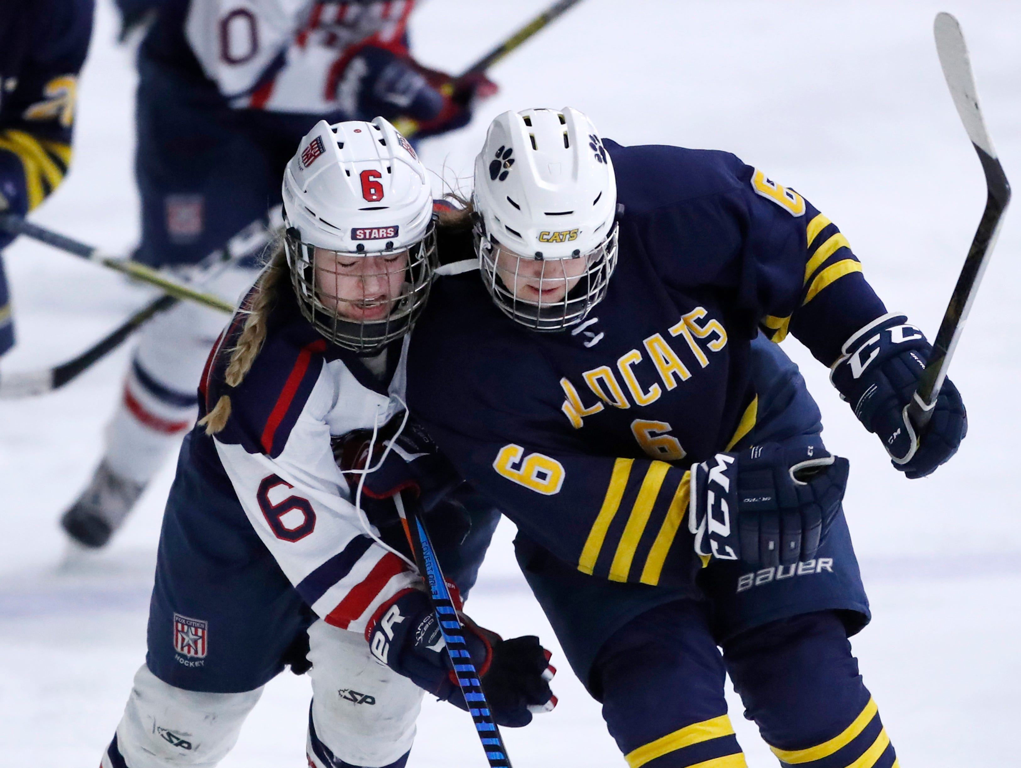 University School Co-opÕs Makinzie Youngblood checks Fox Cities StarsÕ Lauryn Hull for a penalty during their sectional semifinal  Tuesday, Feb. 19, 2019, at the Tri-County Ice Arena in Neenah, Wis.Danny Damiani/USA TODAY NETWORK-Wisconsin