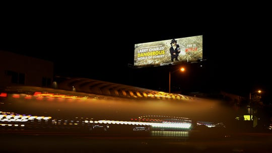 "A billboard for ""Larry Charles' Dangerous World of Comedy"" stands high above Santa Monica Boulevard in Hollywood."
