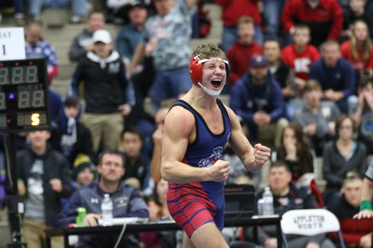 Appleton East's Tyler Locke celebrates his sectional final victory over Green Bay Preble's Kaden Cummings on Saturday at Appleton North High School. Courtesy of Lori Fahrenholz
