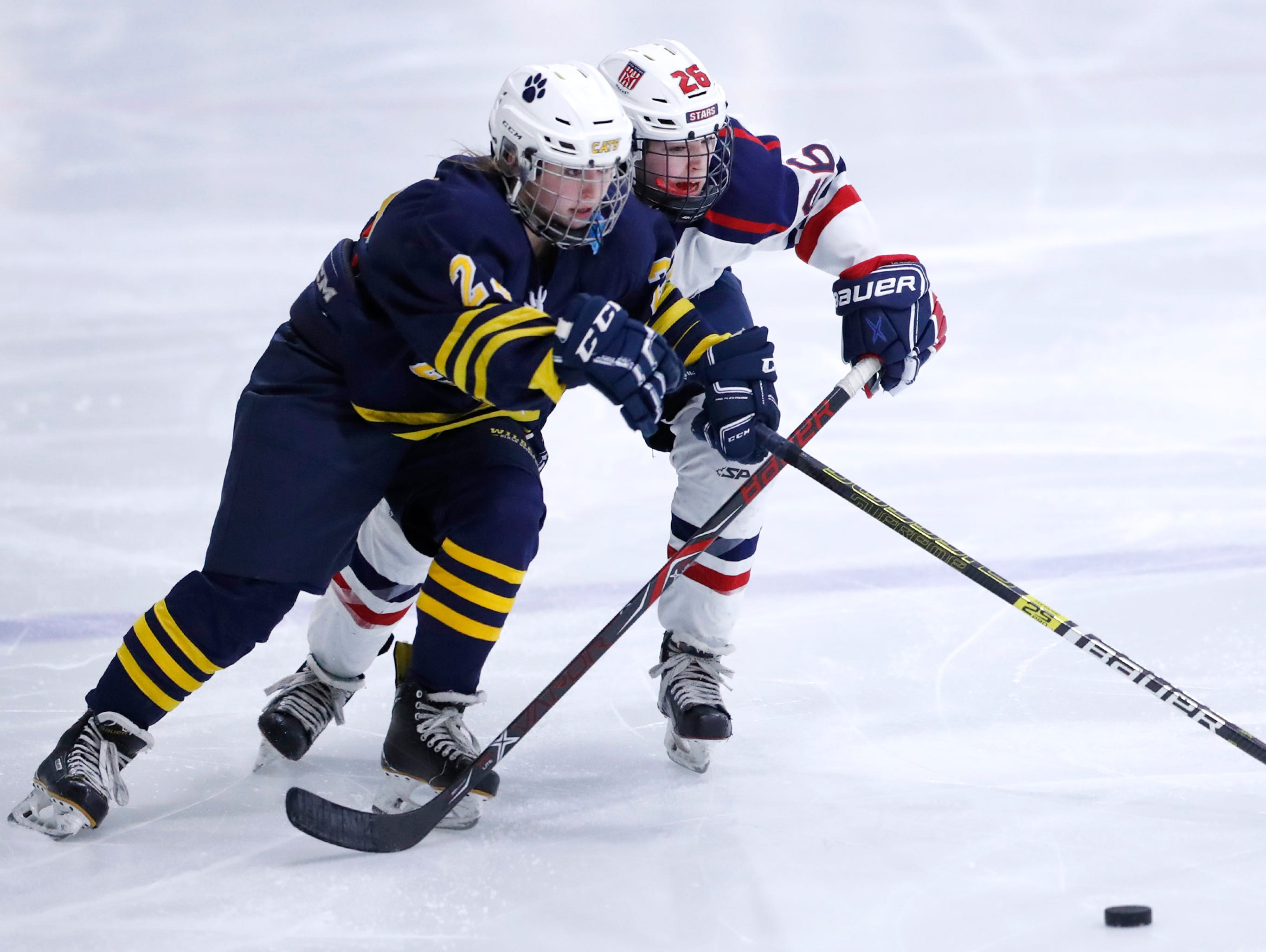 University School Co-opÕs Jordan Bonk and Fox Cities StarsÕ McKayla Zilisch races after the puck during their sectional semifinal Tuesday, Feb. 19, 2019, at theTri-County Ice Arena in Neenah, Wis.Danny Damiani/USA TODAY NETWORK-Wisconsin