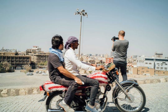 "Aaron Ohlmann, a native of Hortonville, films in Erbil, Iraq. Ohlmann is a producer on the Netflix documentary series ""Larry Charles' Dangerous World of Comedy."""