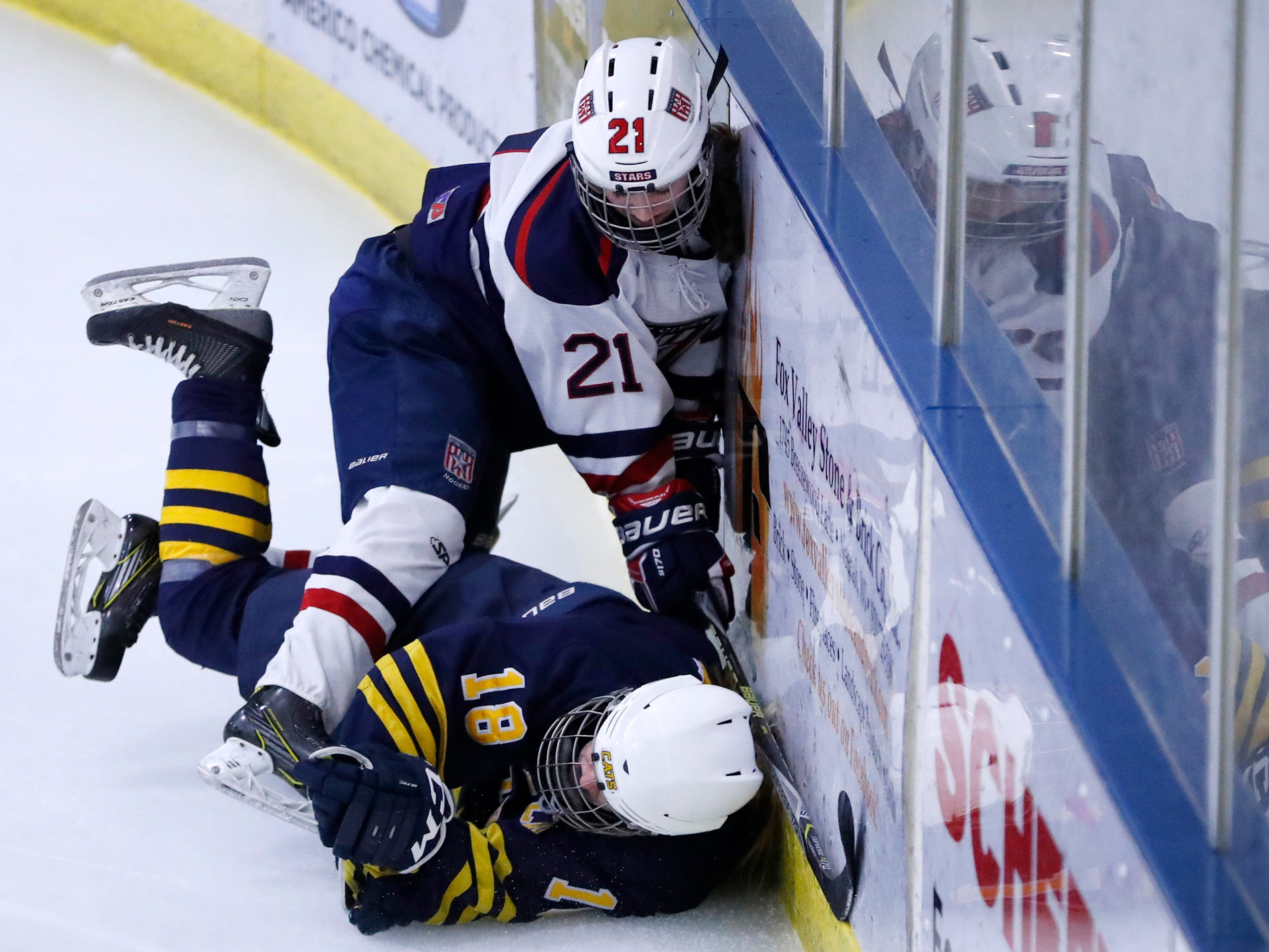 Fox Cities Stars' Sarah Marvin hits the wall after colliding with University School Co-op's Lexie Epperson during their sectional semifinal Tuesday, Feb. 19, 2019, at the Tri-County Ice Arena in Neenah, Wis.Danny Damiani/USA TODAY NETWORK-Wisconsin