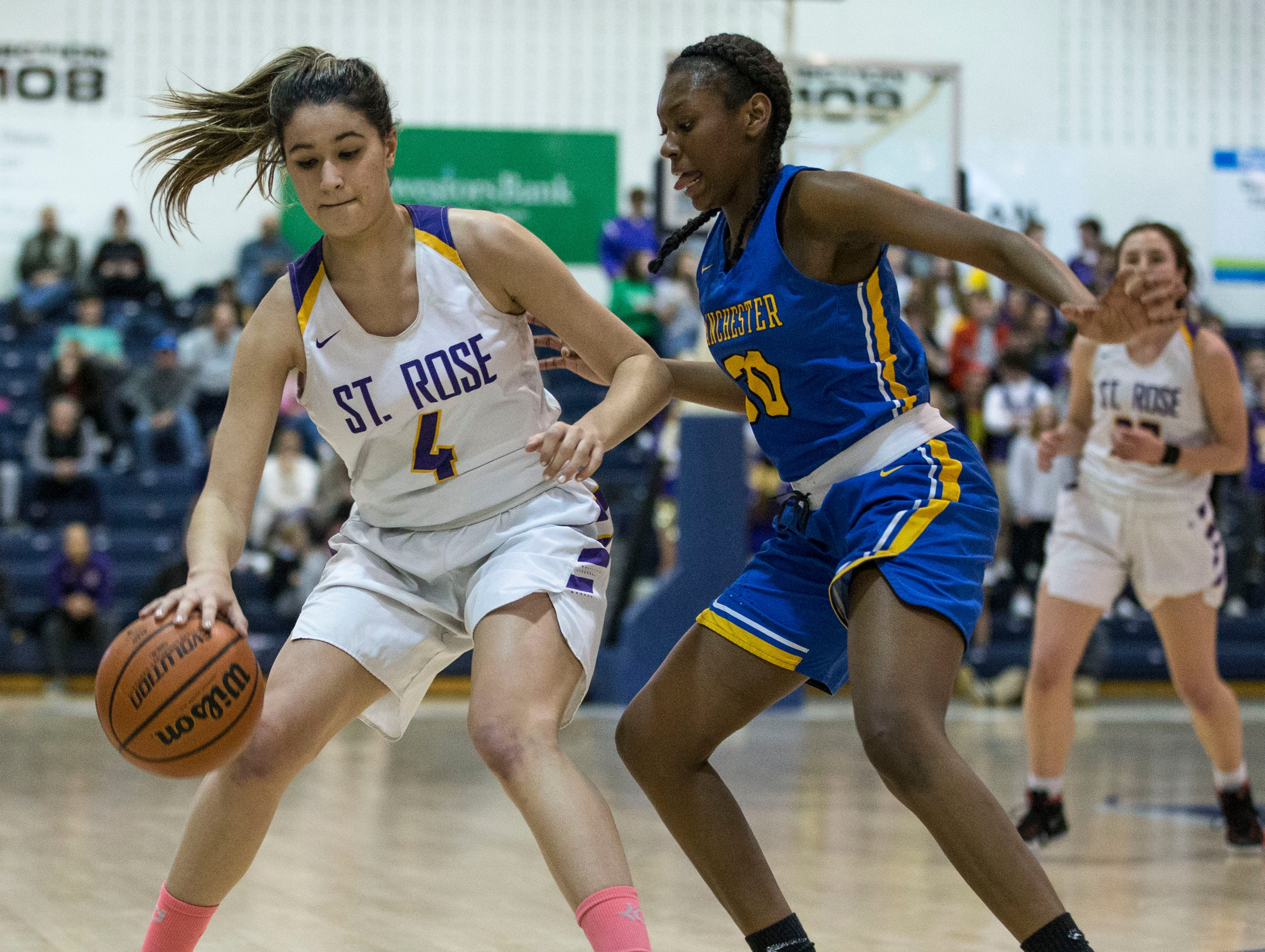 Shore Conference Tournament semifinals featuring St. Rose vs Manchester. St. Rose's Sam Mikos looks to get by Manchester's Serentity Anderson. Toms River, NJTuesday, February 19, 2019