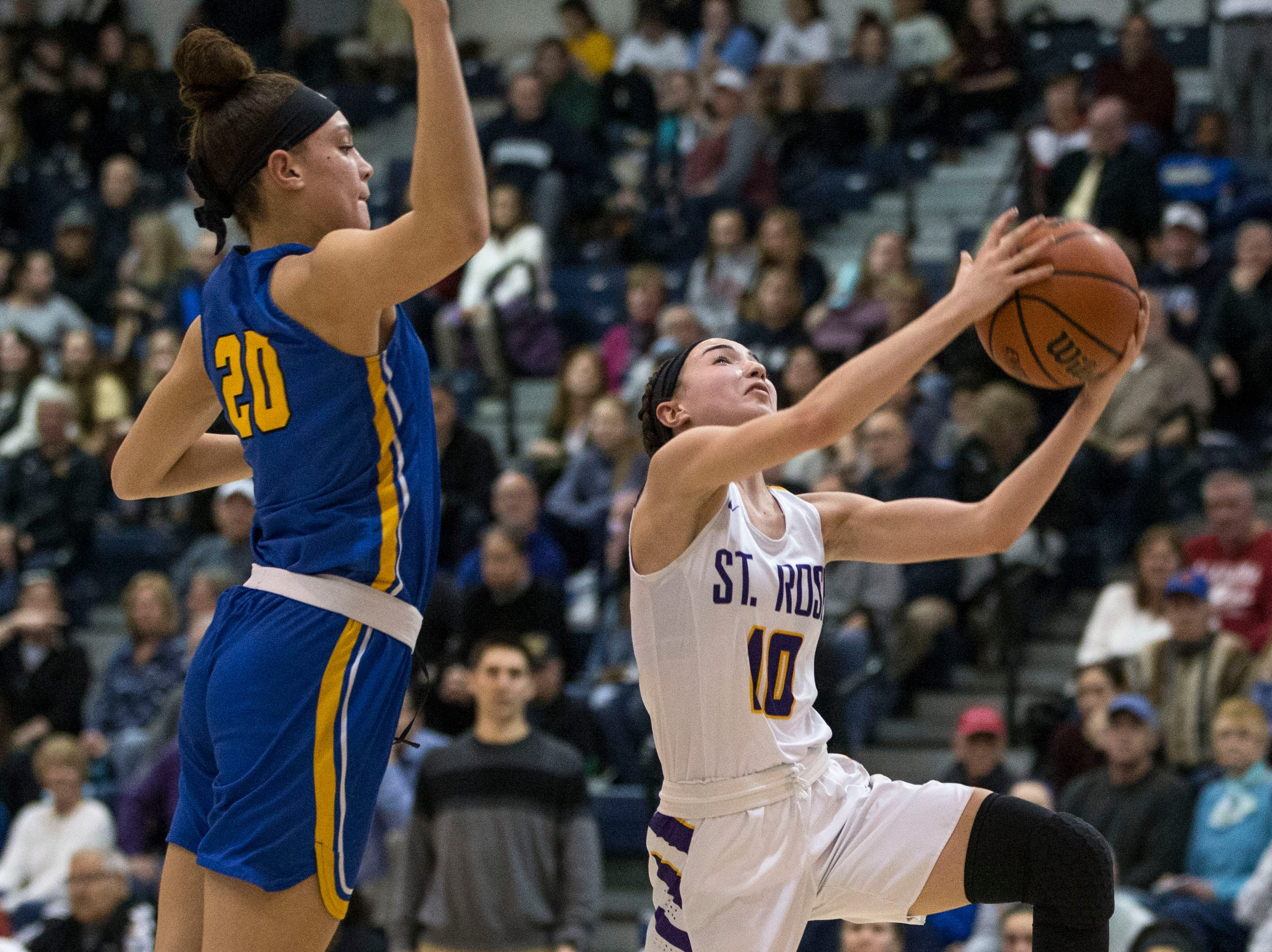Shore Conference Tournament semifinals featuring St. Rose vs Manchester. St. Rose's Abigail Antognoli shoots as Manchester's Destiny Adams defends.Toms River, NJTuesday, February 19, 2019
