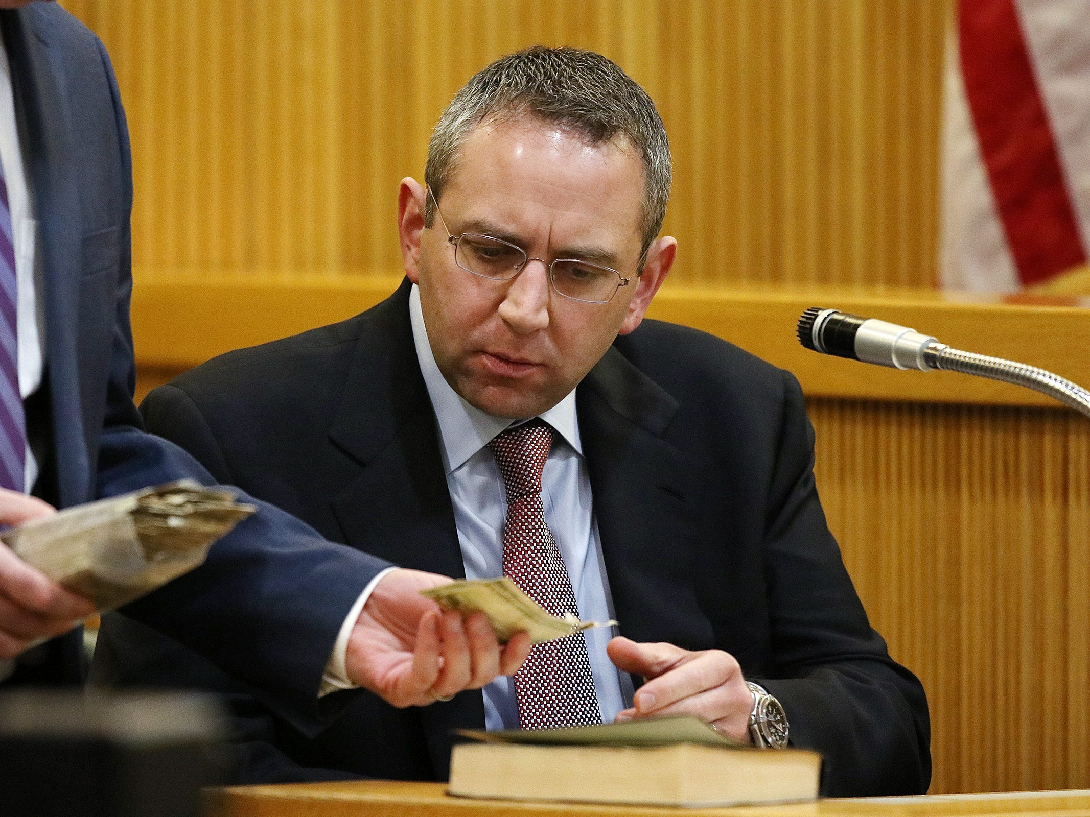 Detective Brian Weisbrot of the Monmouth County Prosecutor's Office, answers questions during redirect about the age of the money found in Sandy Hook as he testifies during the trial of Liam McAtasney, who is charged with the murder of former high school classmate, Sarah Stern, before Superior Court Judge Richard W. English at the Monmouth County Courthouse in Freehold, NJ Wednesday, February 20, 2019.