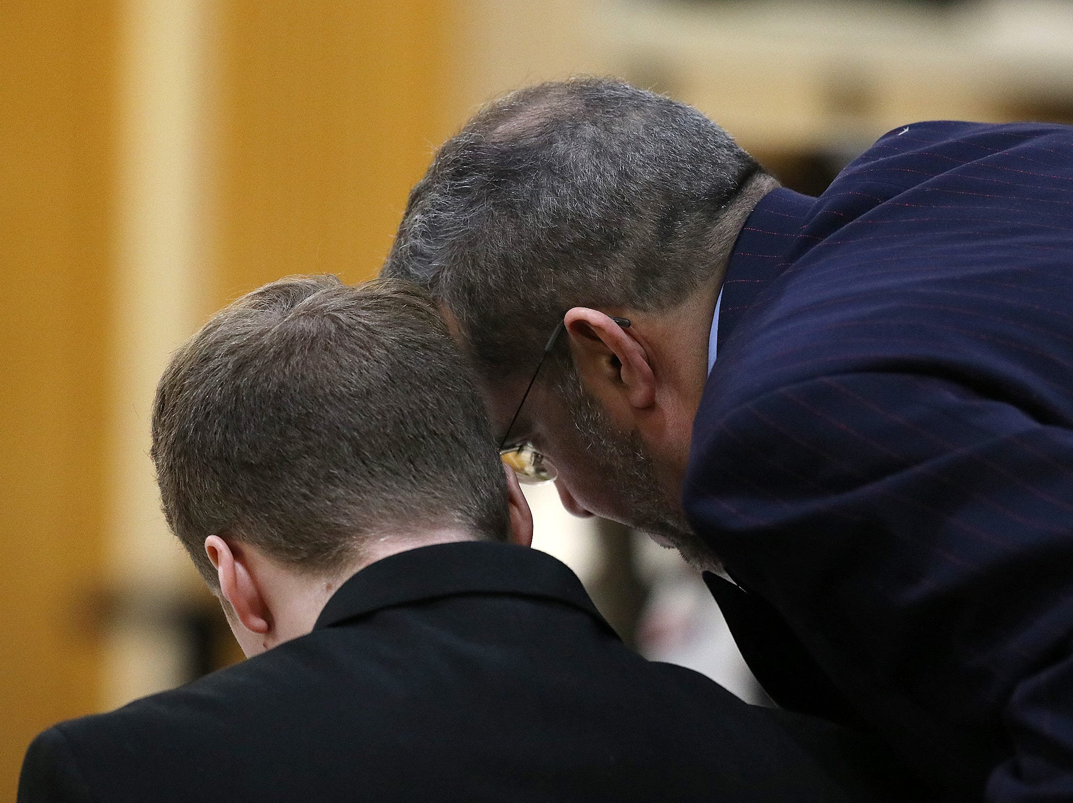 Carlos Diaz-Cobo, defense attorney, takes a moment to speak to his client as he cross examines Brian Weisbrot, a detective of the Monmouth County Prosecutor's Office, during the trial of Liam McAtasney, who is charged with the murder of former high school classmate, Sarah Stern, before Superior Court Judge Richard W. English at the Monmouth County Courthouse in Freehold, NJ Wednesday, February 20, 2019.