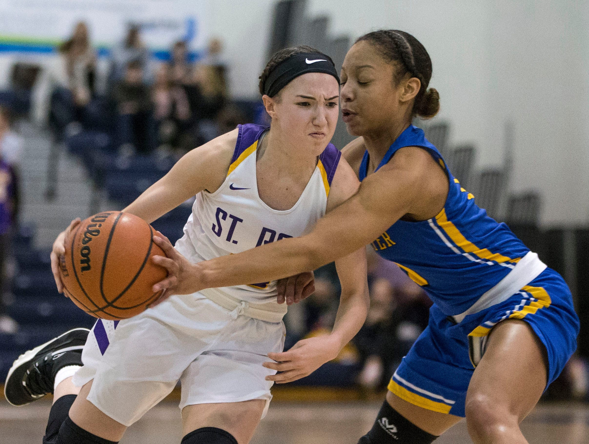 Shore Conference Tournament semifinals featuring St. Rose vs Manchester. St. Rose's Abigail Antognoli drives past Manchester's Kemari Reynolds. Toms River, NJTuesday, February 19, 2019