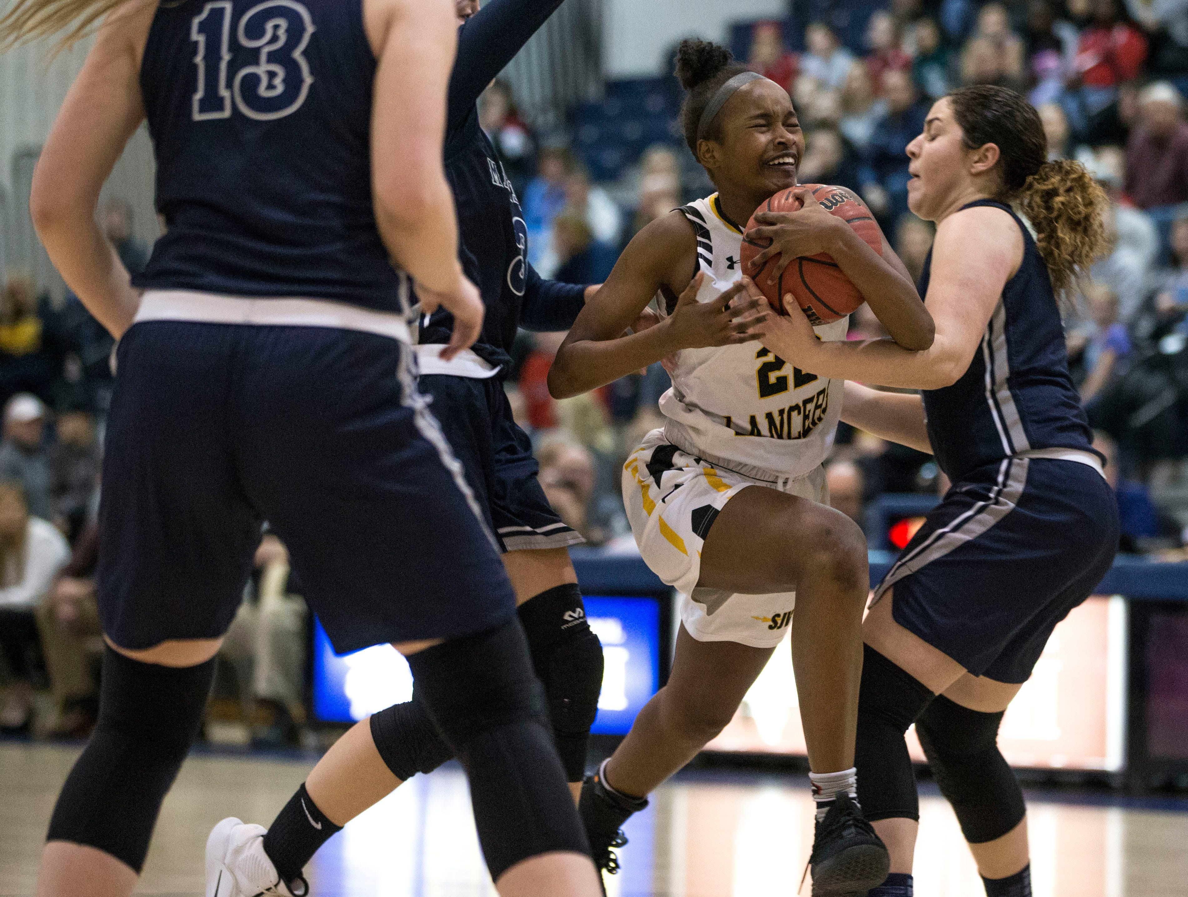 Shore Conference Tournament semifinals featuring Saint John Vianney vs Manasquan. Saint John Vianney's Madison St. Rose drives to the hoop.Toms River, NJTuesday, February 19, 2019