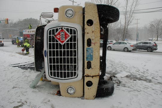 A tanker truck overturned on a snow-covered Route 571 in Manchester Feb. 20.