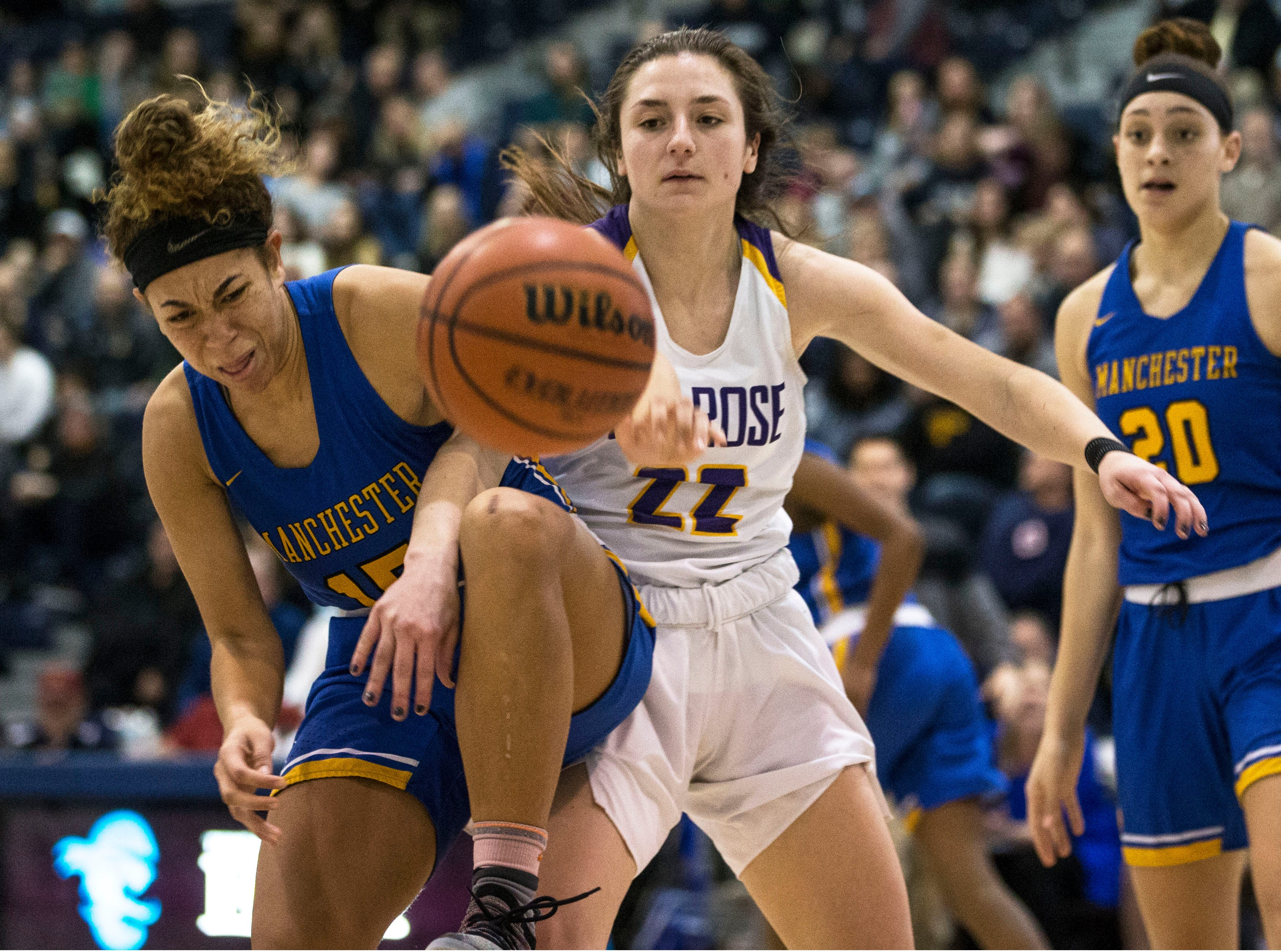 Shore Conference Tournament semifinals featuring St. Rose vs Manchester. Manchester's Dakota Adams and St. Rose's Brynn Farrell battle for a rebound. Toms River, NJTuesday, February 19, 2019