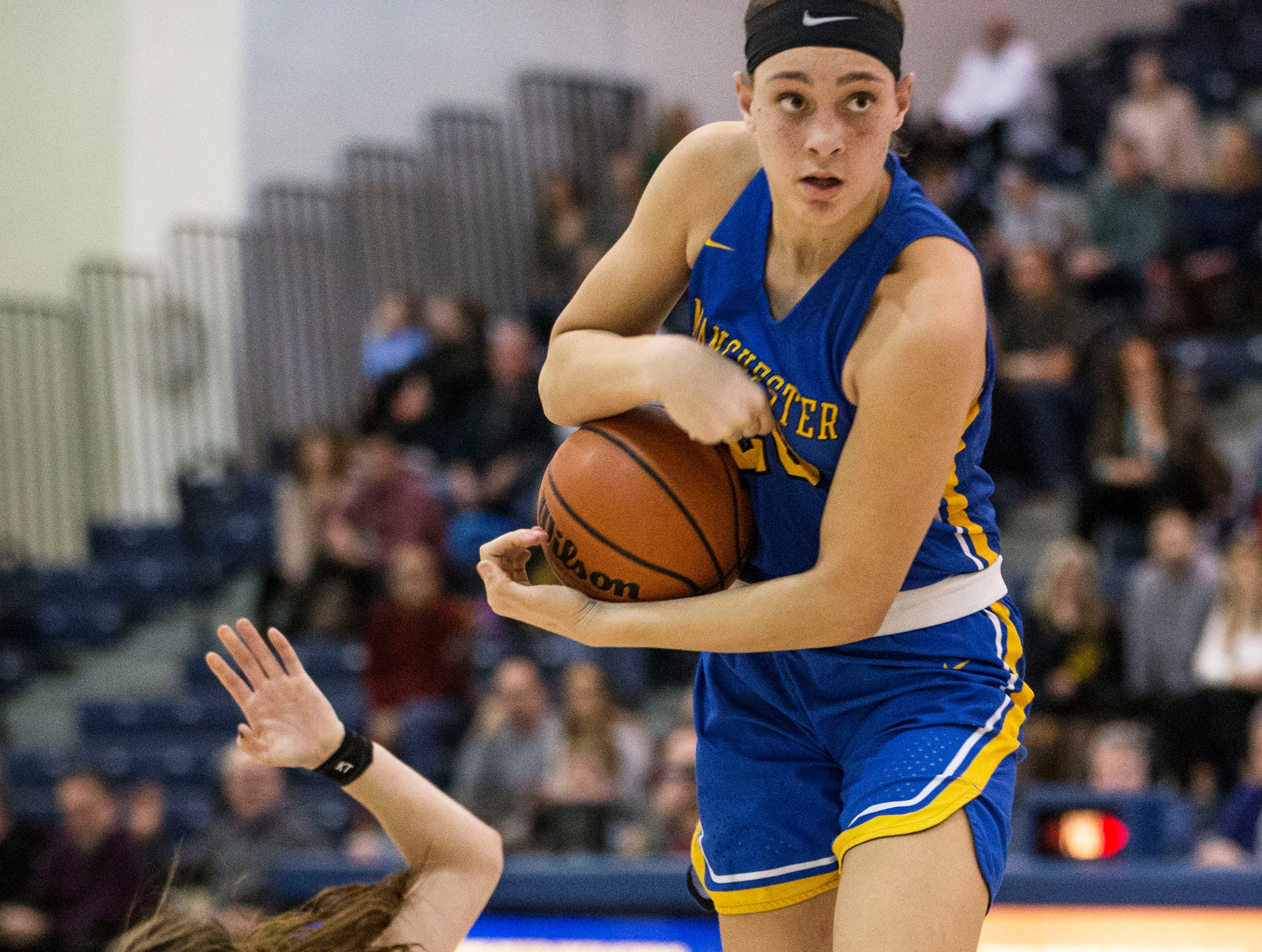 Shore Conference Tournament semifinals featuring St. Rose vs Manchester. Manchester's Destiny Adams comes up with the ball as St. Rose's Brynn Farrell goes to the floor.Toms River, NJTuesday, February 19, 2019