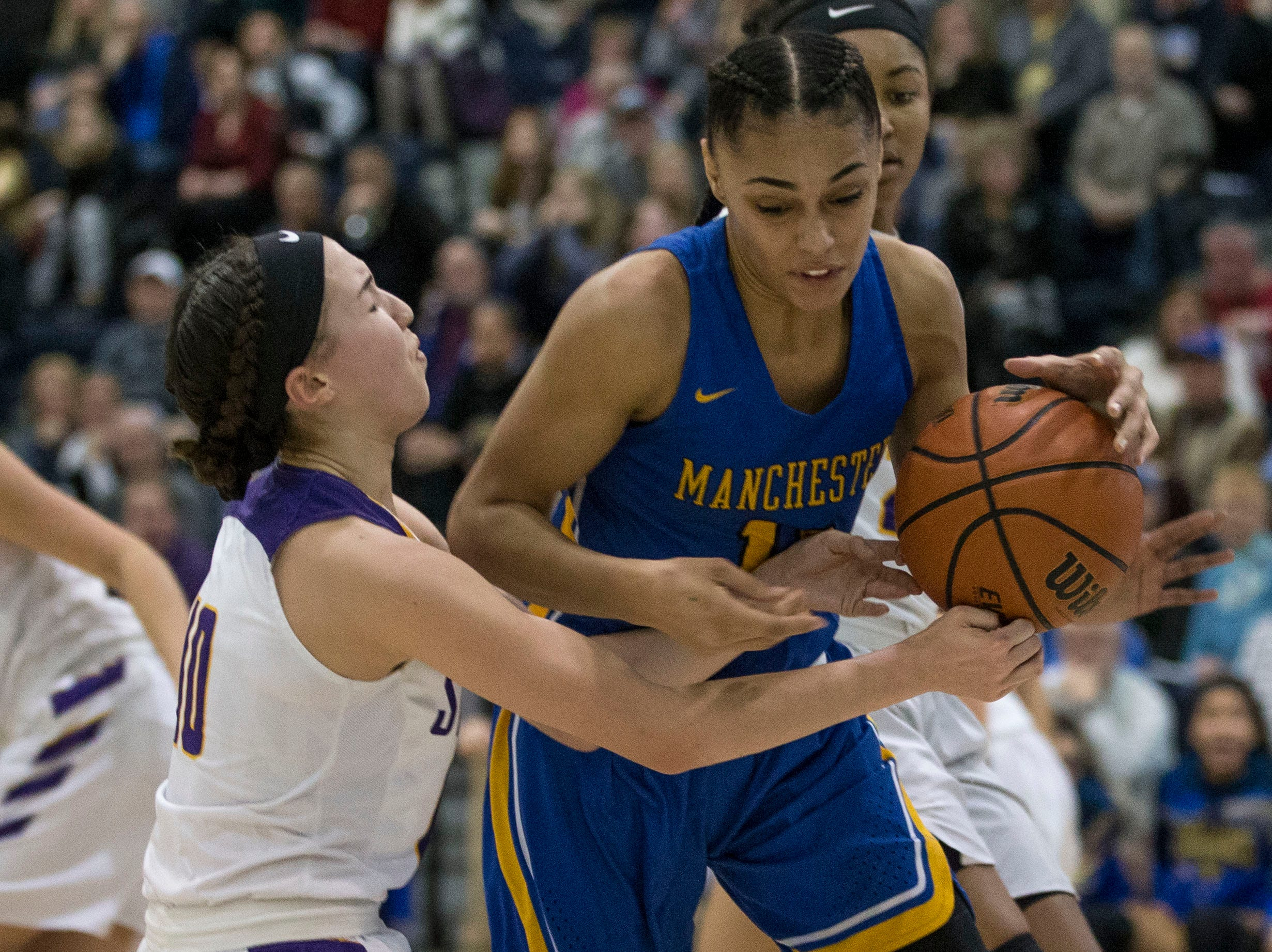 Shore Conference Tournament semifinals featuring St. Rose vs Manchester. St. Rose's Abigail Antognoli and Manchester's Leilani Correa battle for a rebound.Toms River, NJTuesday, February 19, 2019