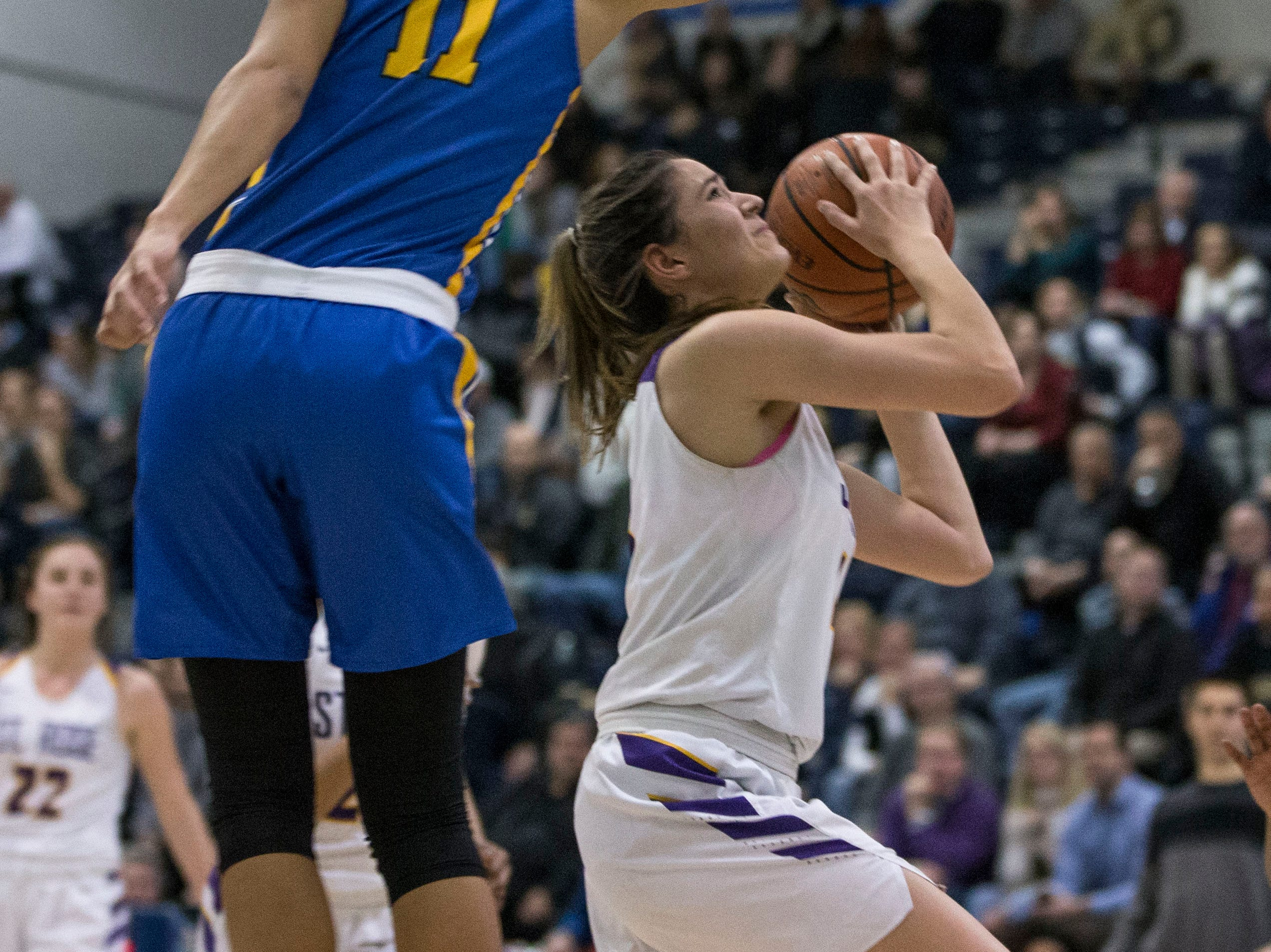 Shore Conference Tournament semifinals featuring St. Rose vs Manchester. St. Rose's Sam Mikos shoots as Manchester's Leilani Correa defends.Toms River, NJTuesday, February 19, 2019