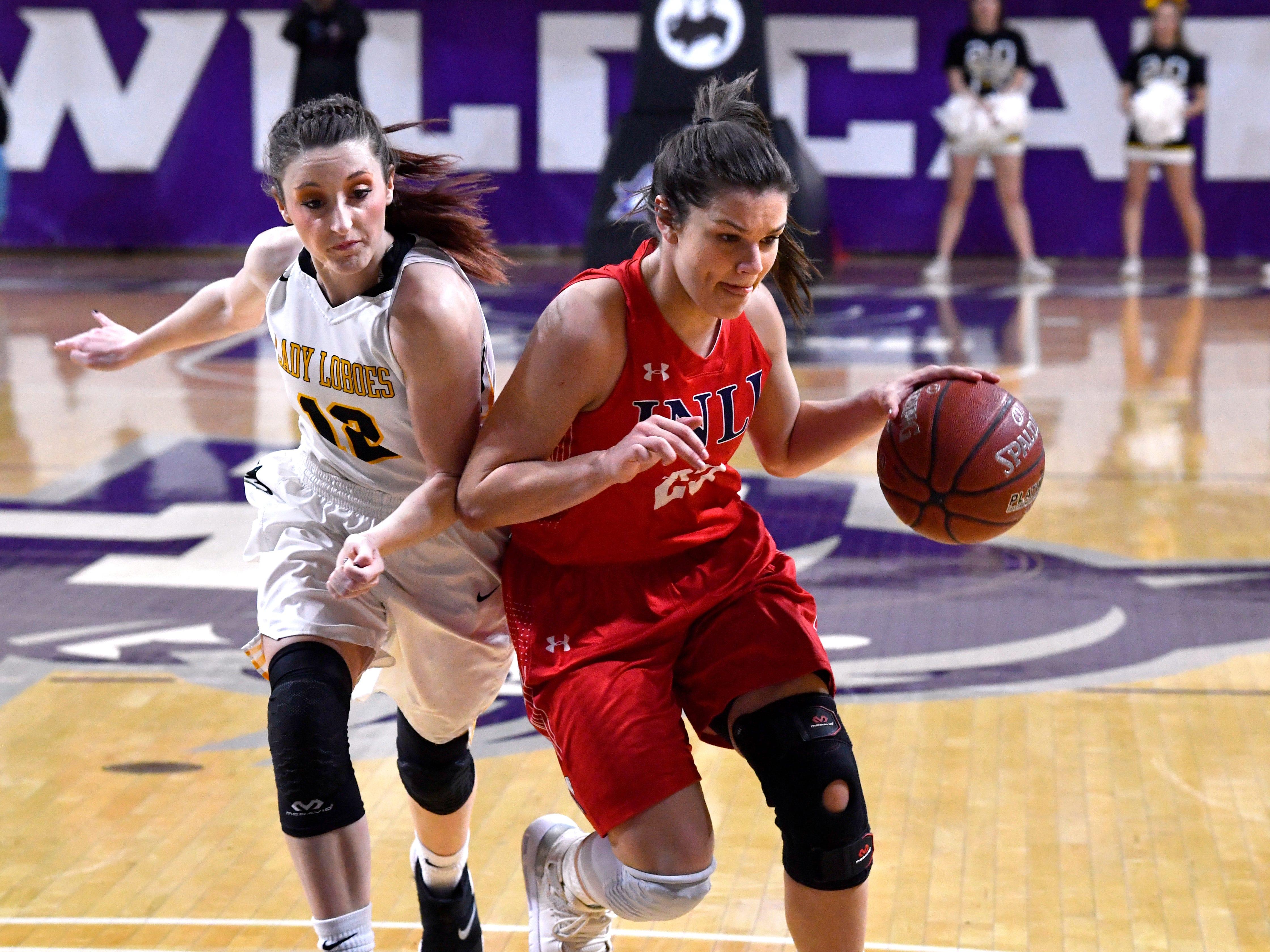 Cisco's Katelyn Bird (left) bumps Jim Ned's Libby Tutt during Tuesday's Region 1 3A basketball all quarter-finals at Abilene Christian University Feb. 19, 2019. Final score was 46-31, Jim Ned.