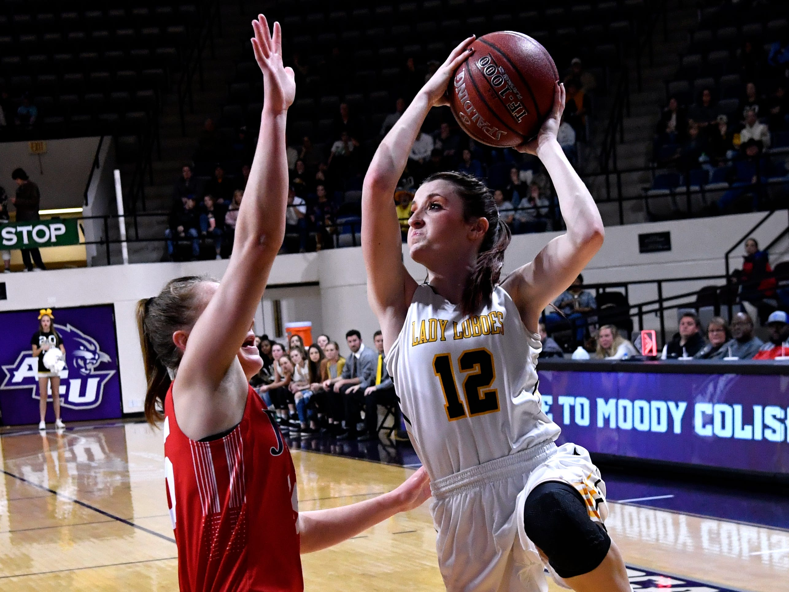 Cisco's Katelyn Bird tries for a basket during Tuesday's Region 1 3A basketball all quarter-finals at Abilene Christian University Feb. 19, 2019. Final score was 46-31, Jim Ned.